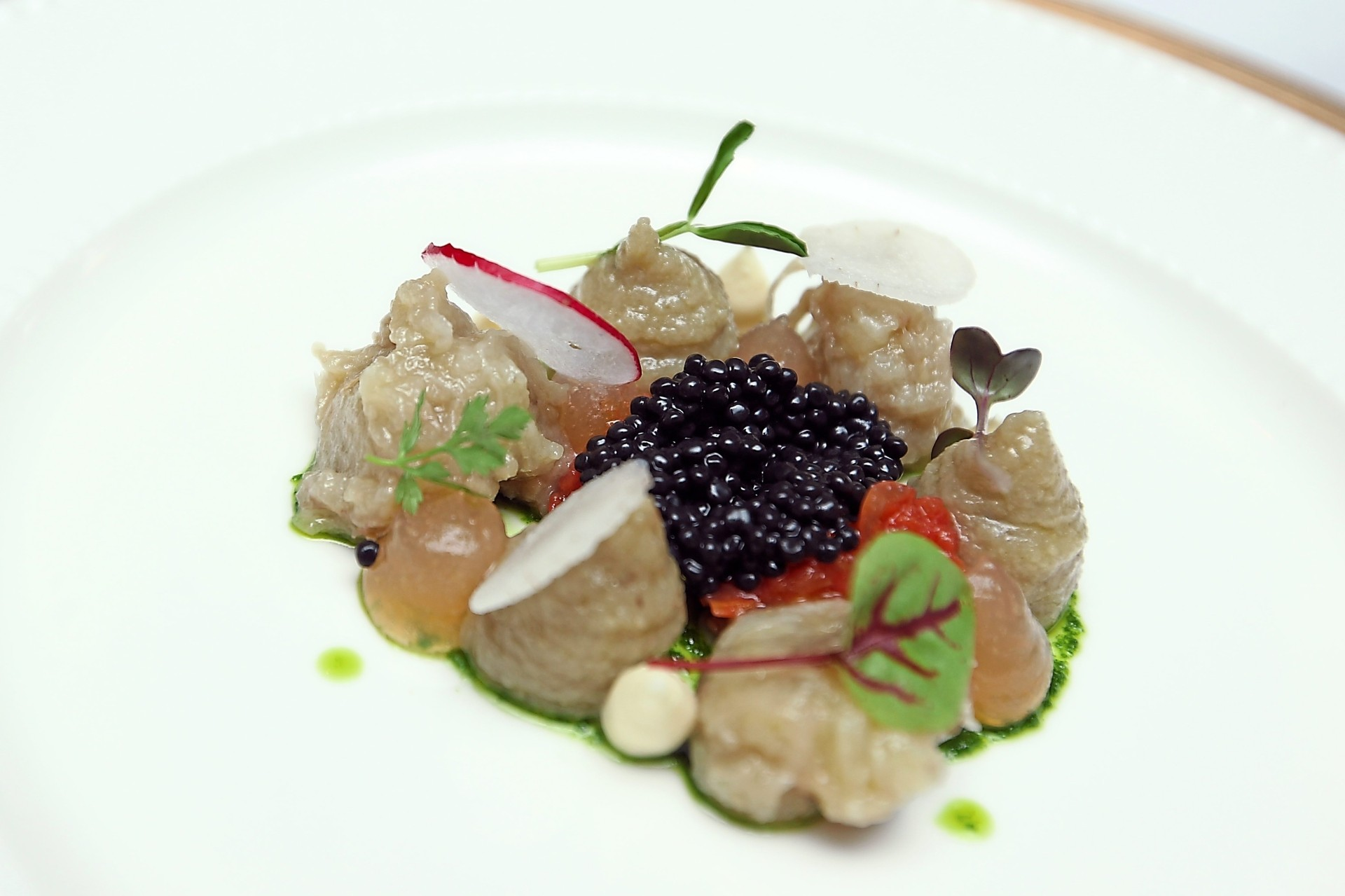 Poached nasu garnished with avruga caviar and drops of grape juice jelly comes as a starter.