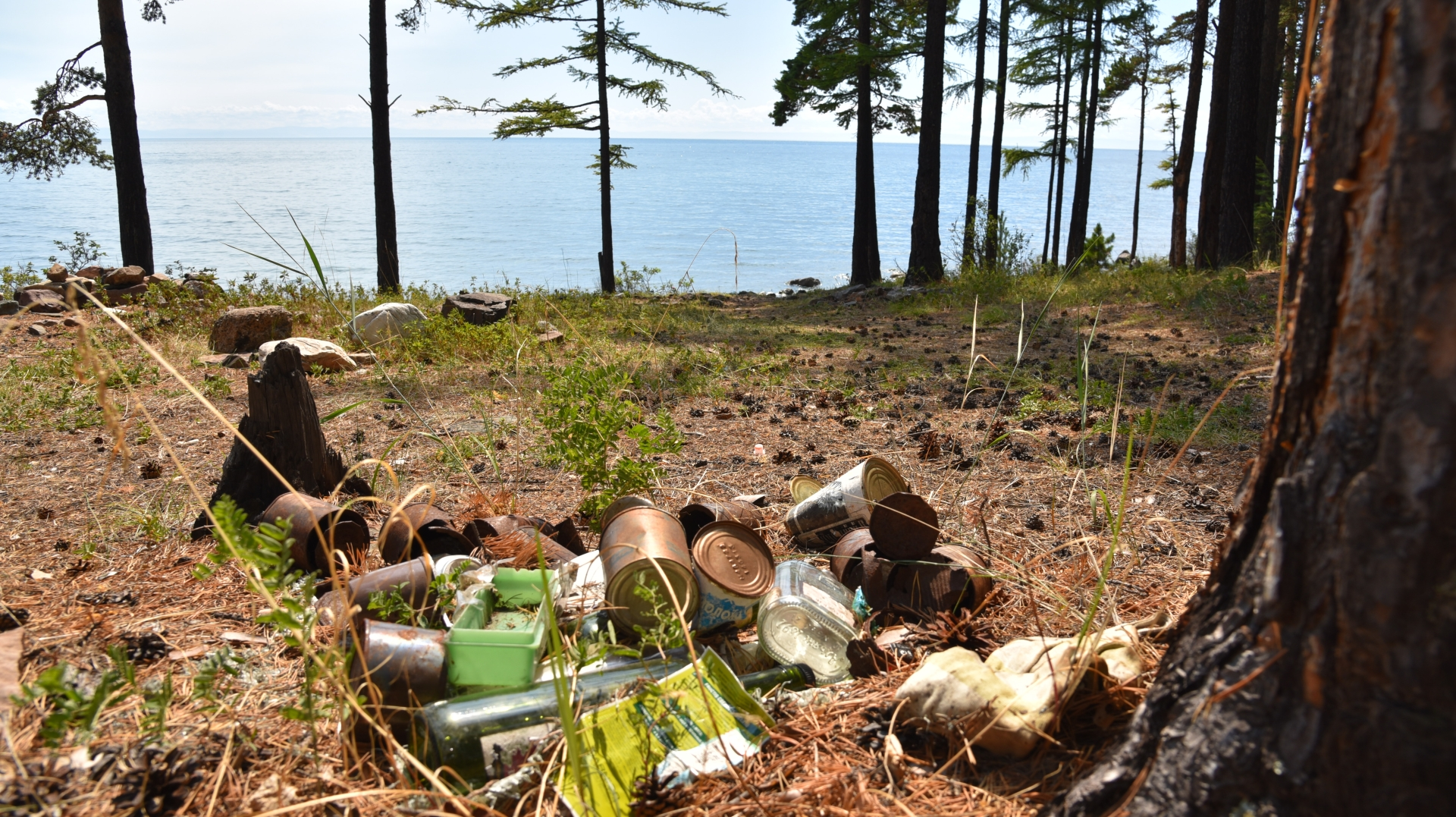 Some tourists camp around Lake Baikal illegally, leaving their rubbish behind.