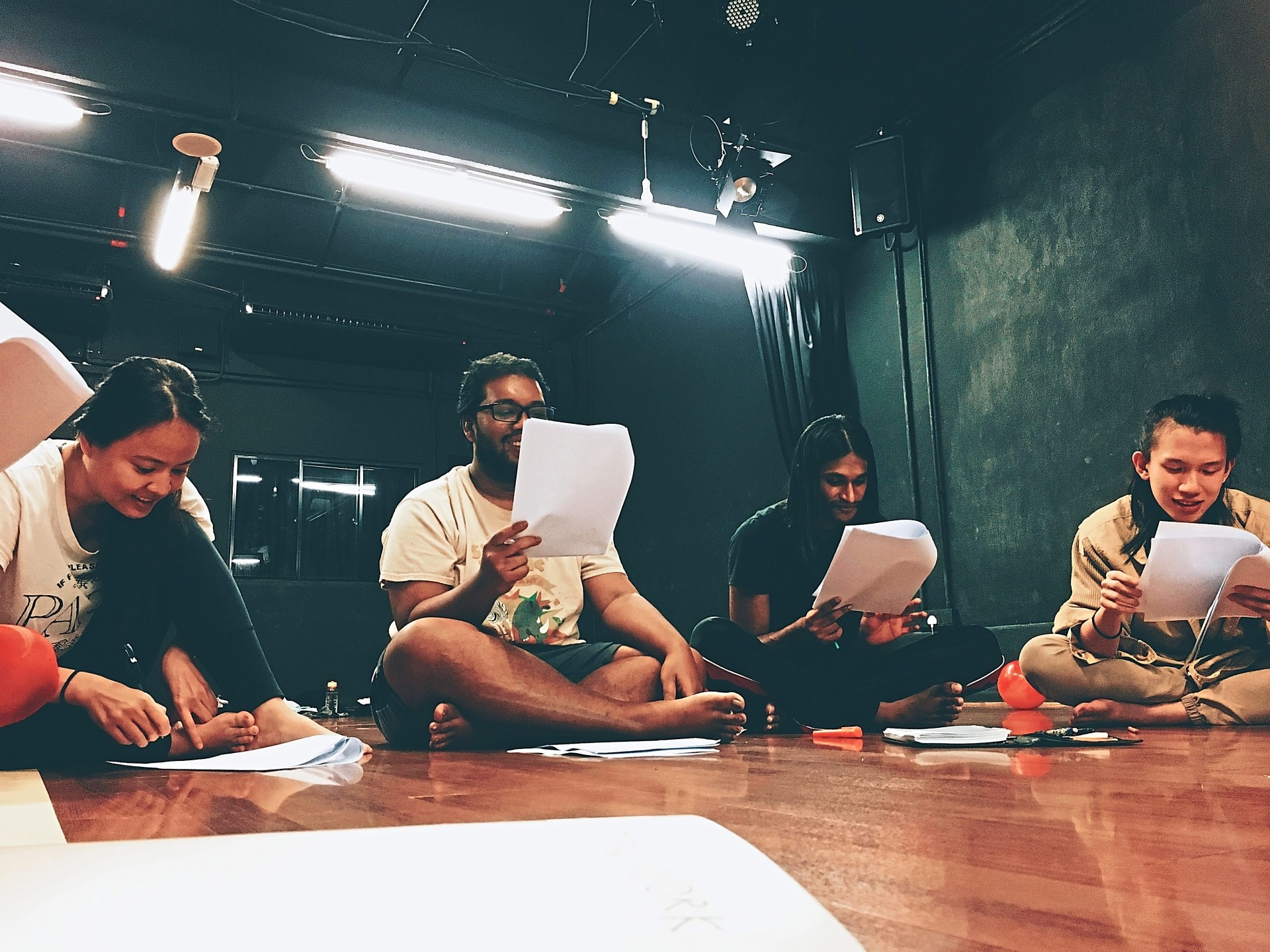 Hana Nadira (left), one of the assistant directors, together with cast members Ashraf Modee Zain, Joshua Navin and Tristen Loo devising a scene for Brohemia! Photo: Theatresauce