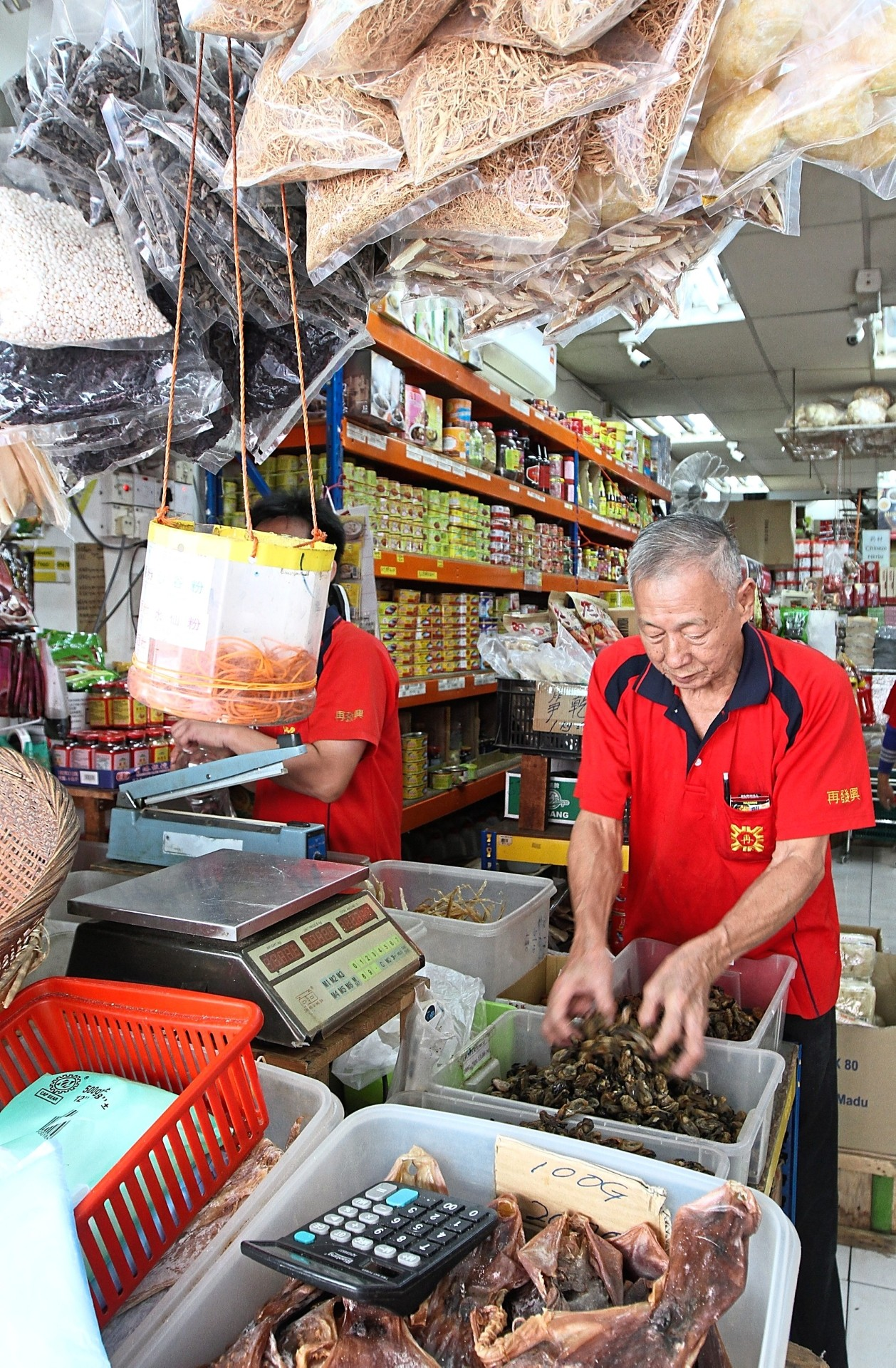 Kuala Lumpur's Tun HS Lee Street, also known as 'Hai Kai' (High Street) is a showcase of traditional trade, such as this dried goods store.