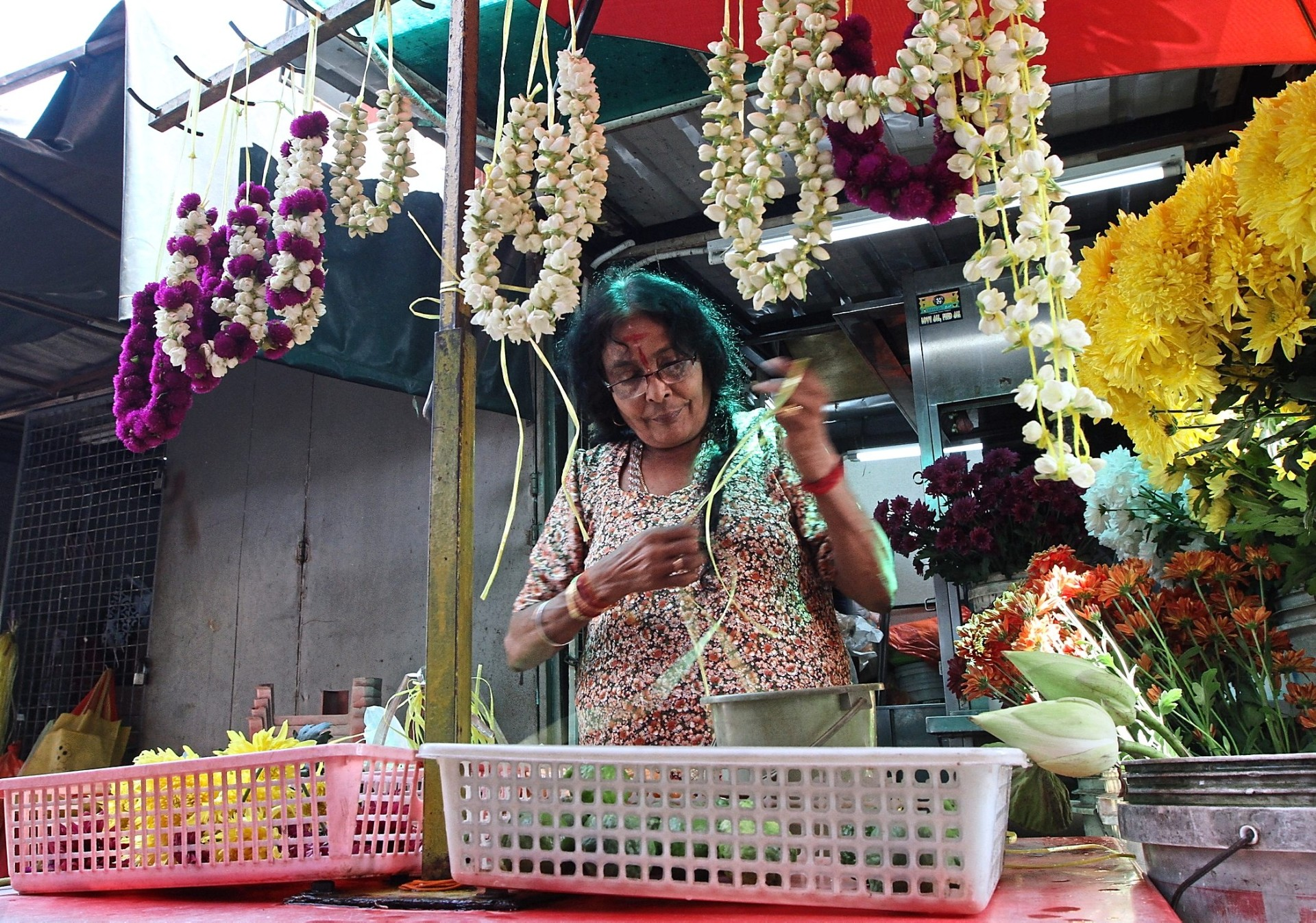 One of many stalls selling fresh flowers along Jalan Hang Lekir.