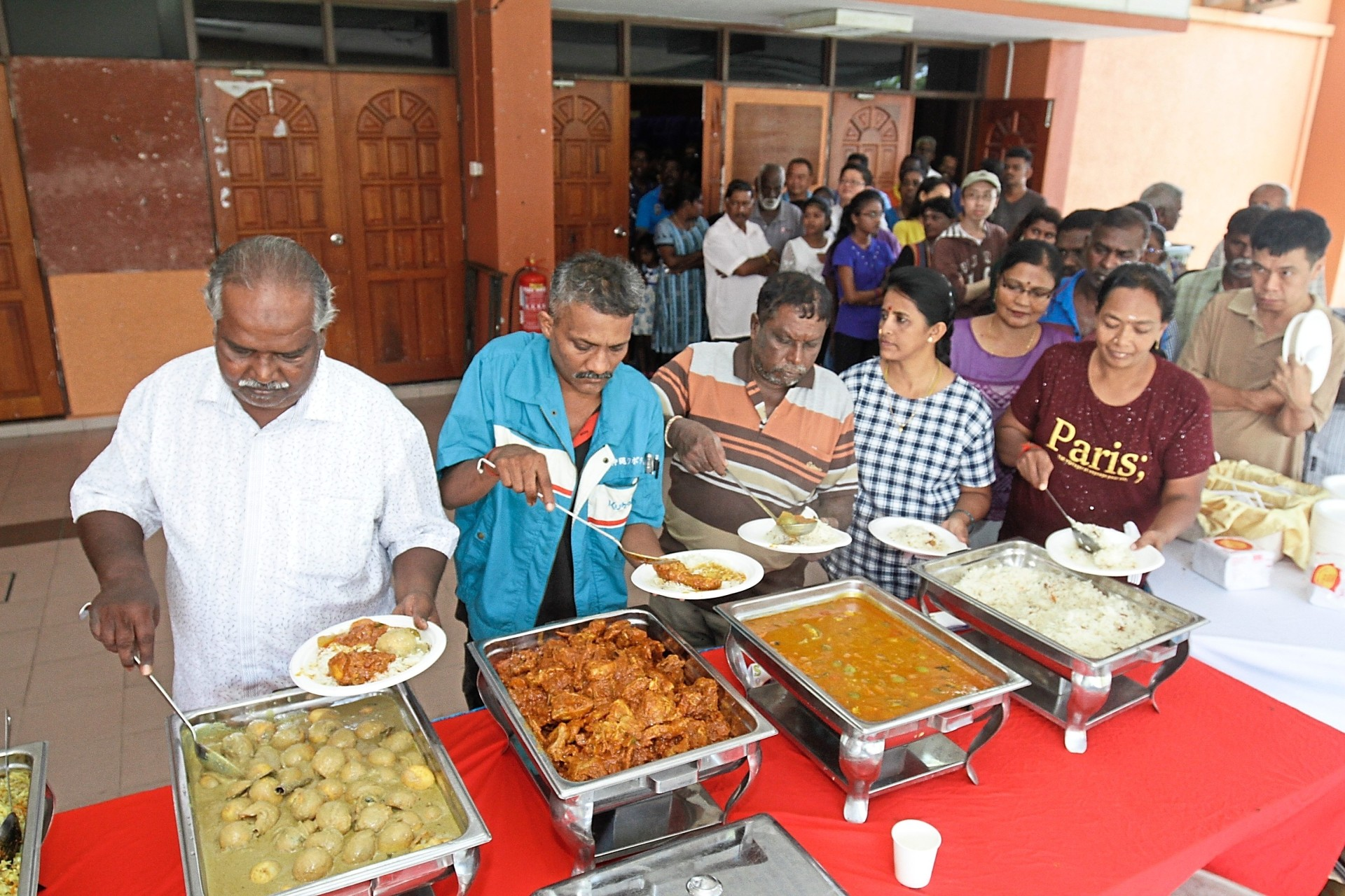 Members of the public helping themselves to the sumptuous buffet.