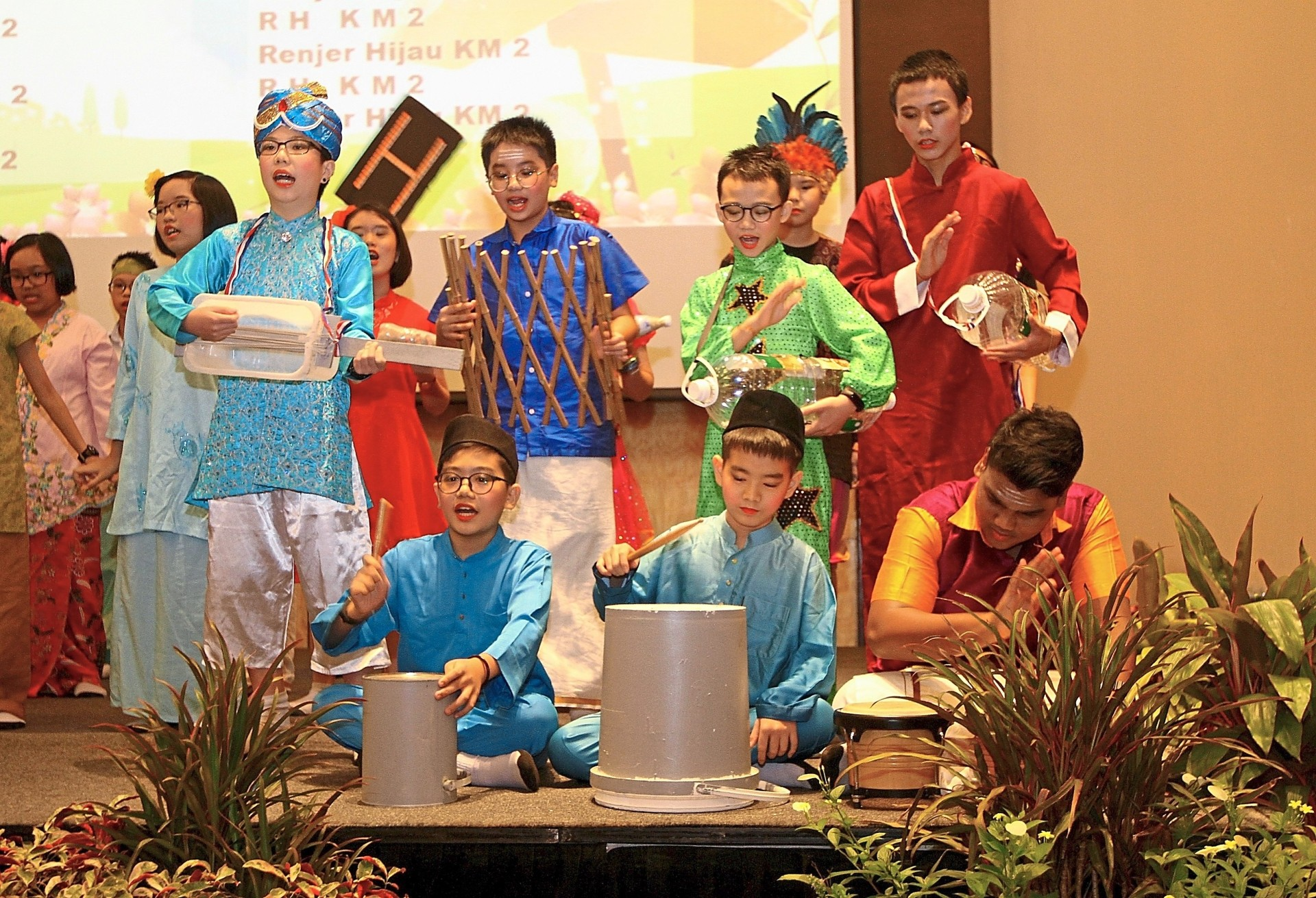 'Green Warriors' of SJK(C) Kong Min 2 performing a musical dance on stage using recyclable items during the Penang Green School Awards 2019 ceremony at Jen Hotel in George Town, Penang.