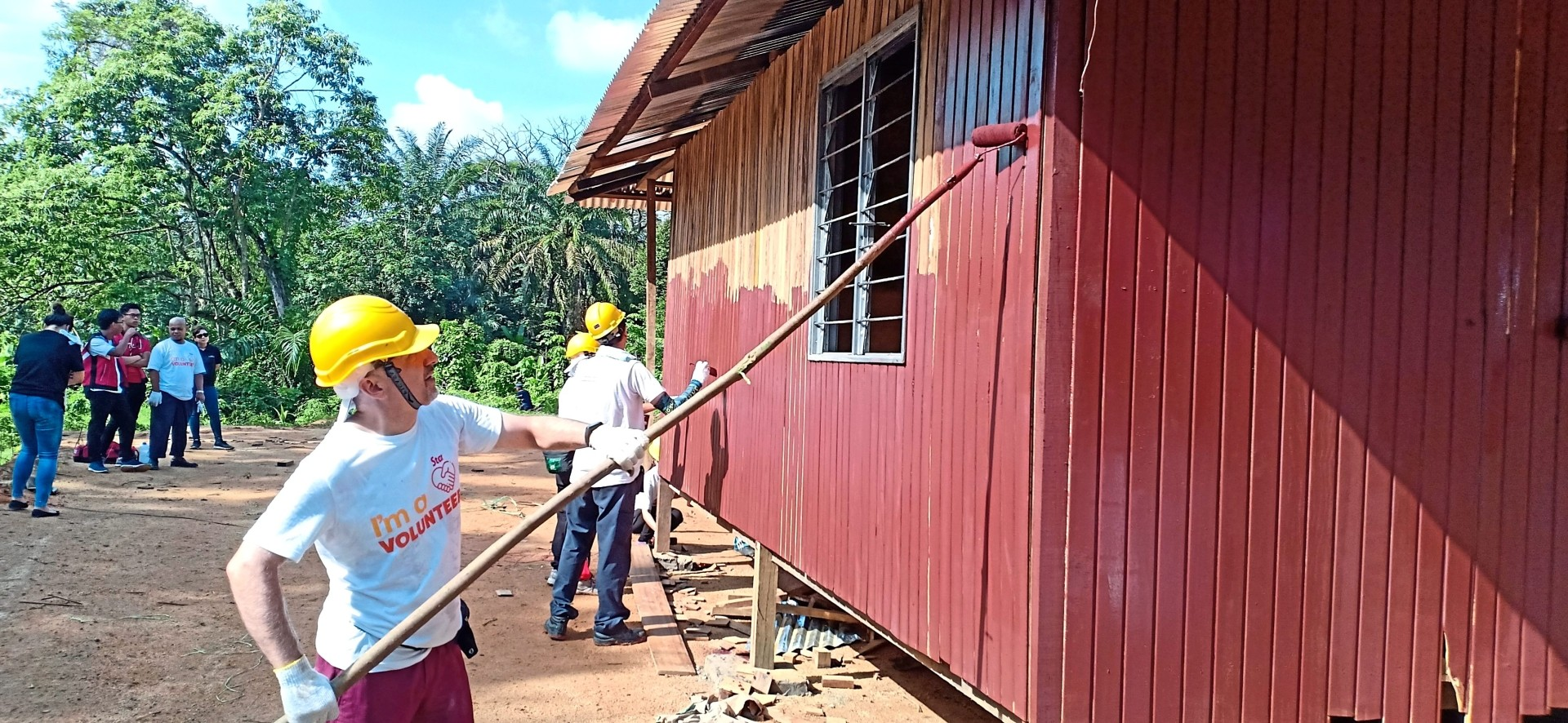 One of the houses being painted as a finishing touch.