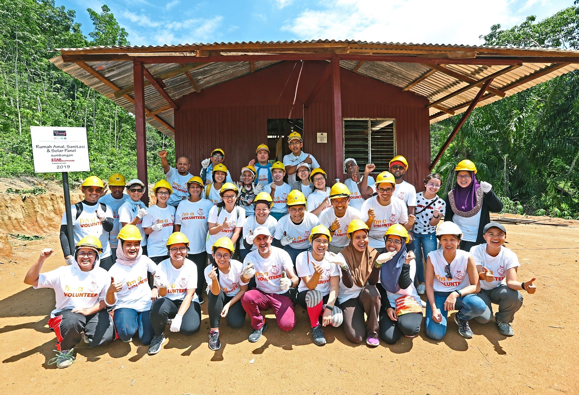 Star Media Group staff happy with what they achieved — building two houses for two Orang Asli families in Negri Sembilan in two days.
