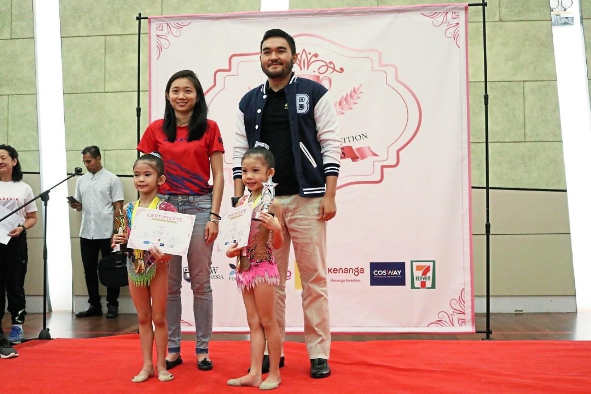 Lau and Tengku Amir with two participants at the Princess Rhythmic Gymnastics Championship.