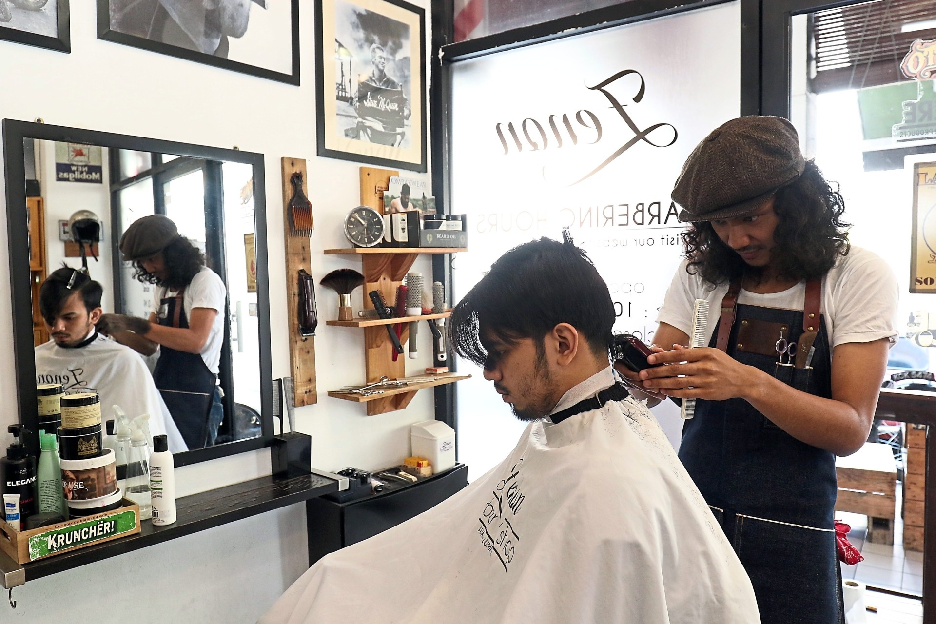 One of the things Faez Zenon enjoys about barbering is the human connection where his clients have become his friends over the years. Photo: FAIHAN GHANI/The Star