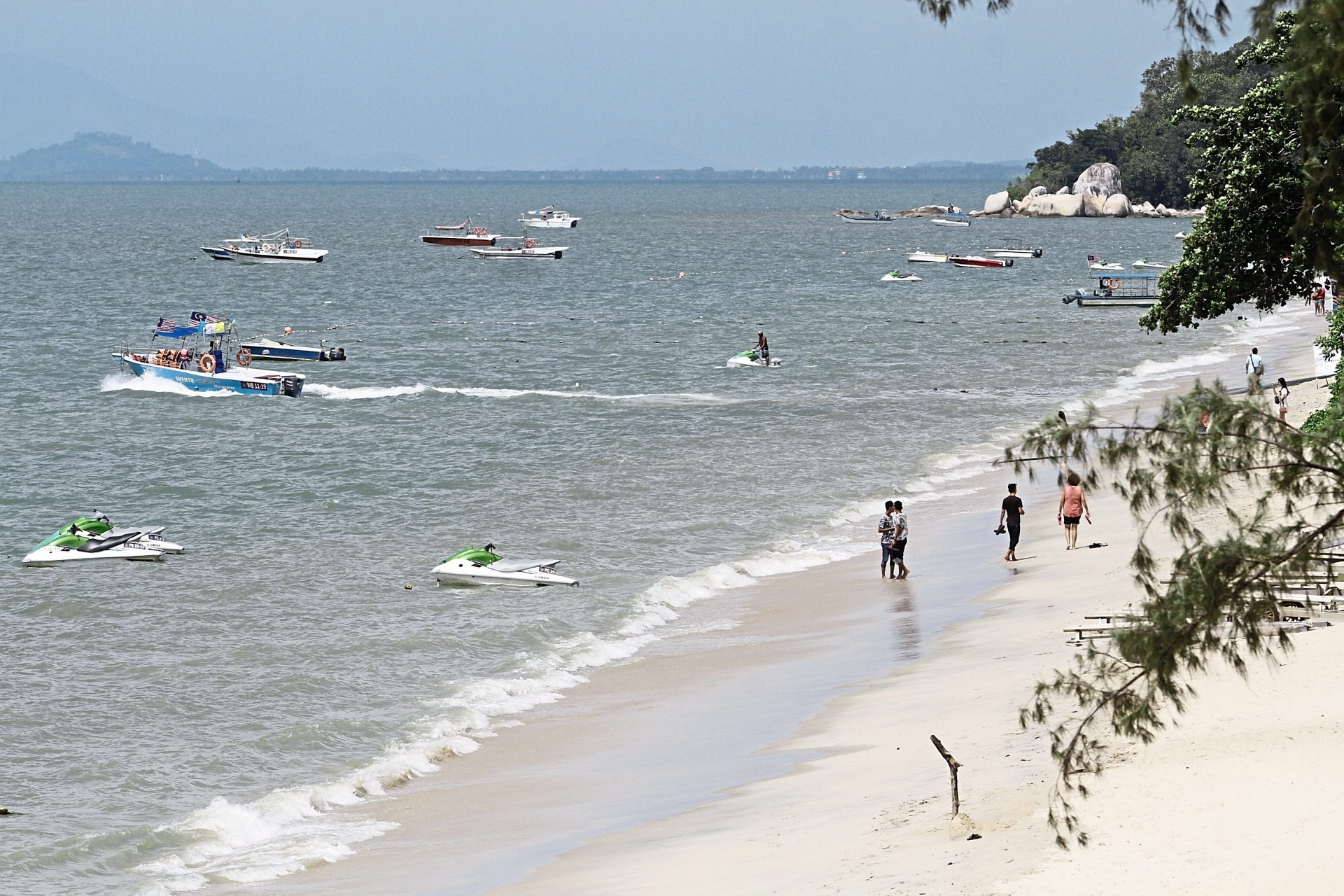 A general view of beachgoers at Batu Ferringhi. Under the company's proposal, the reclaimed site will be turned into an international resort with hotels, commercial areas and serviced apartments.
