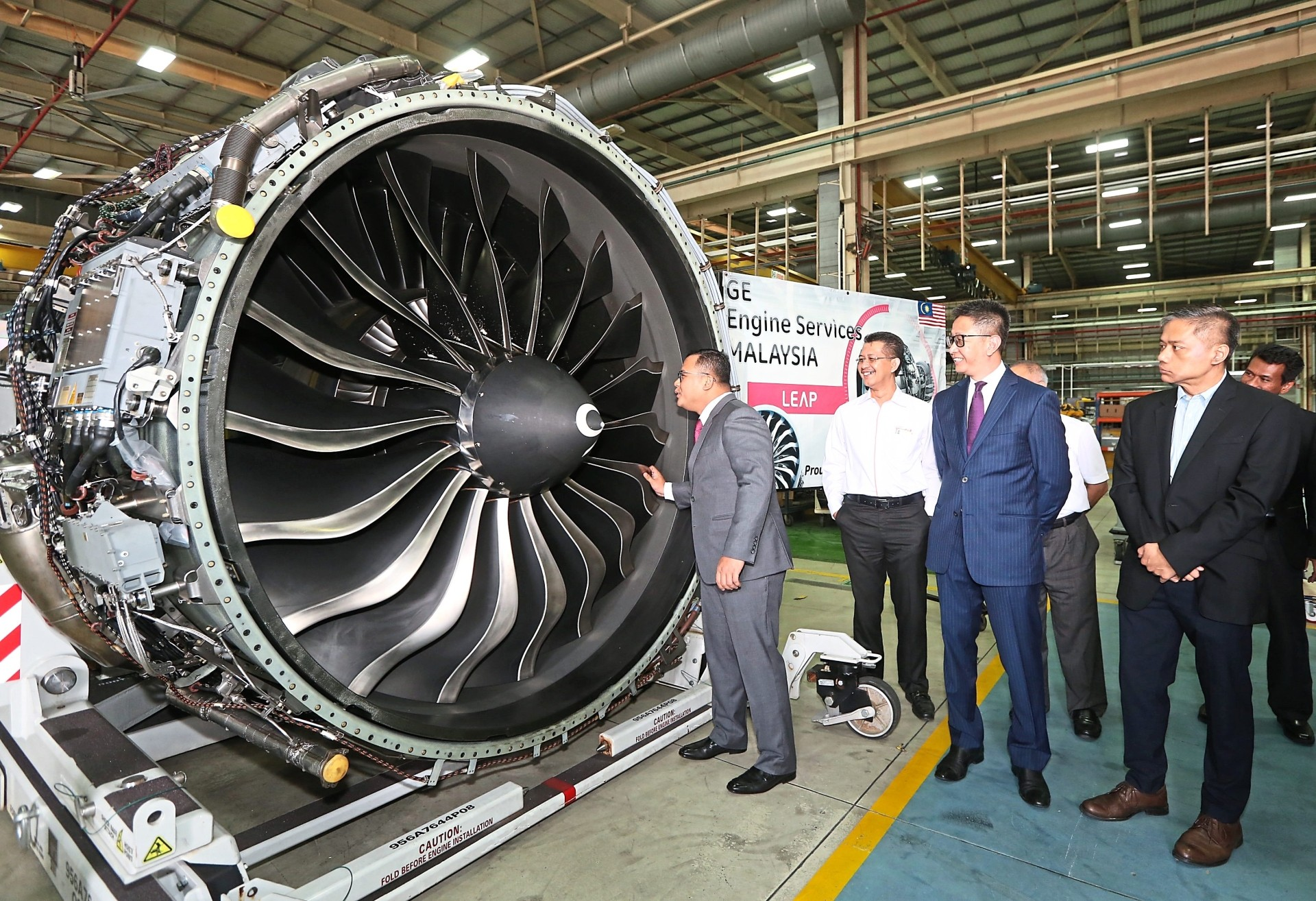 Smart Selangor is the highlight of Budget 2020, says Amirudin who is looking into an airplane engine after attending a Smart Selangor apprenticeship graduation in this file photo.