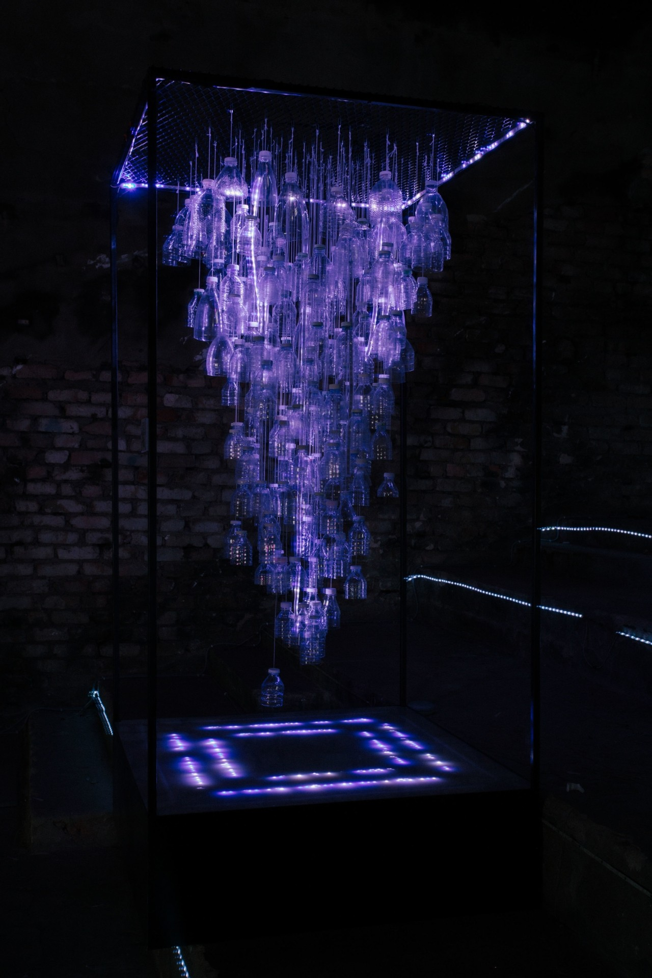 Multimedia University's H2O's Digital Shui (LED strips, water bottles, 2019). Photo: Helios Loo