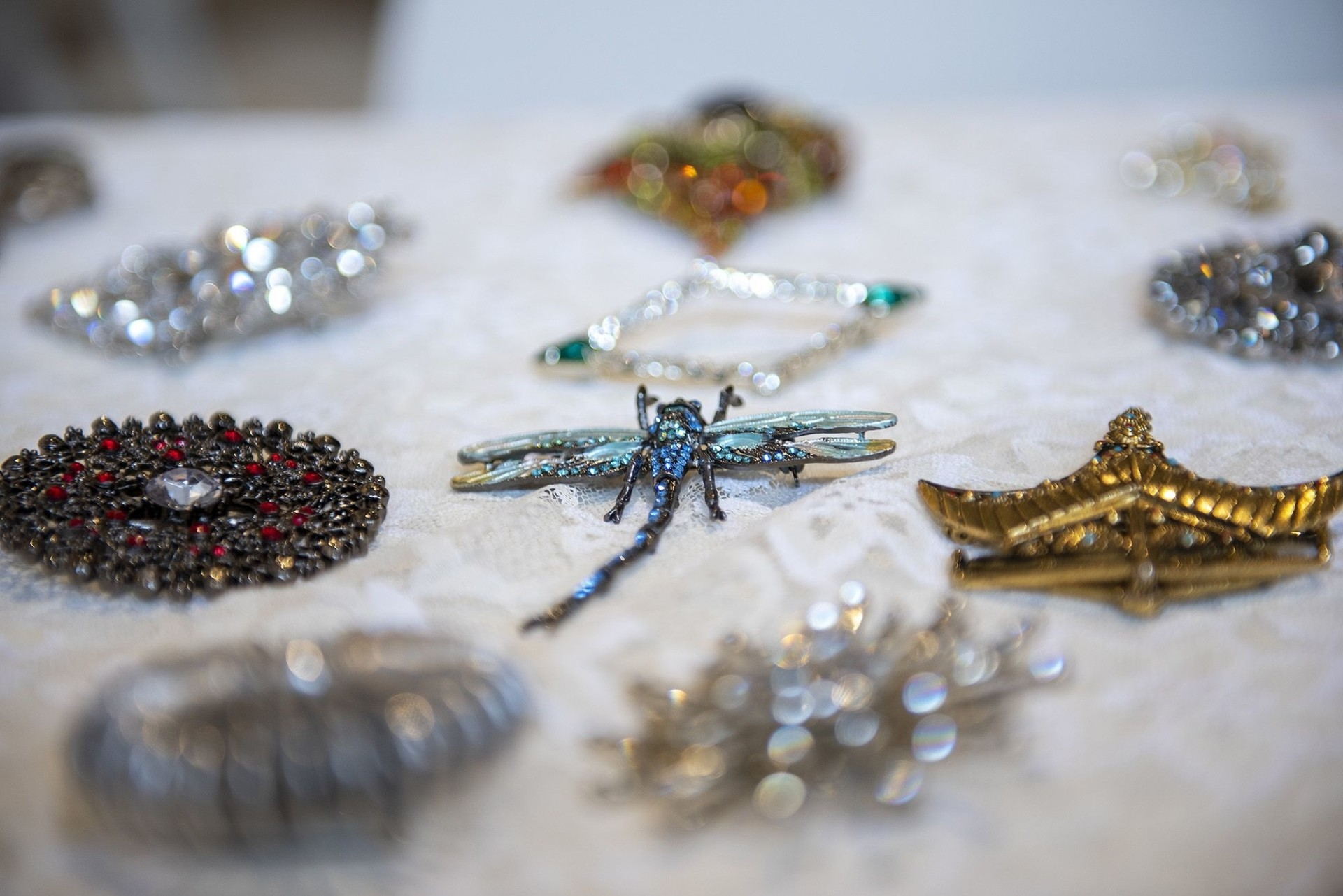 A small part of Caruso's brooch collection, which she showed at Frieda's restaurant recently.