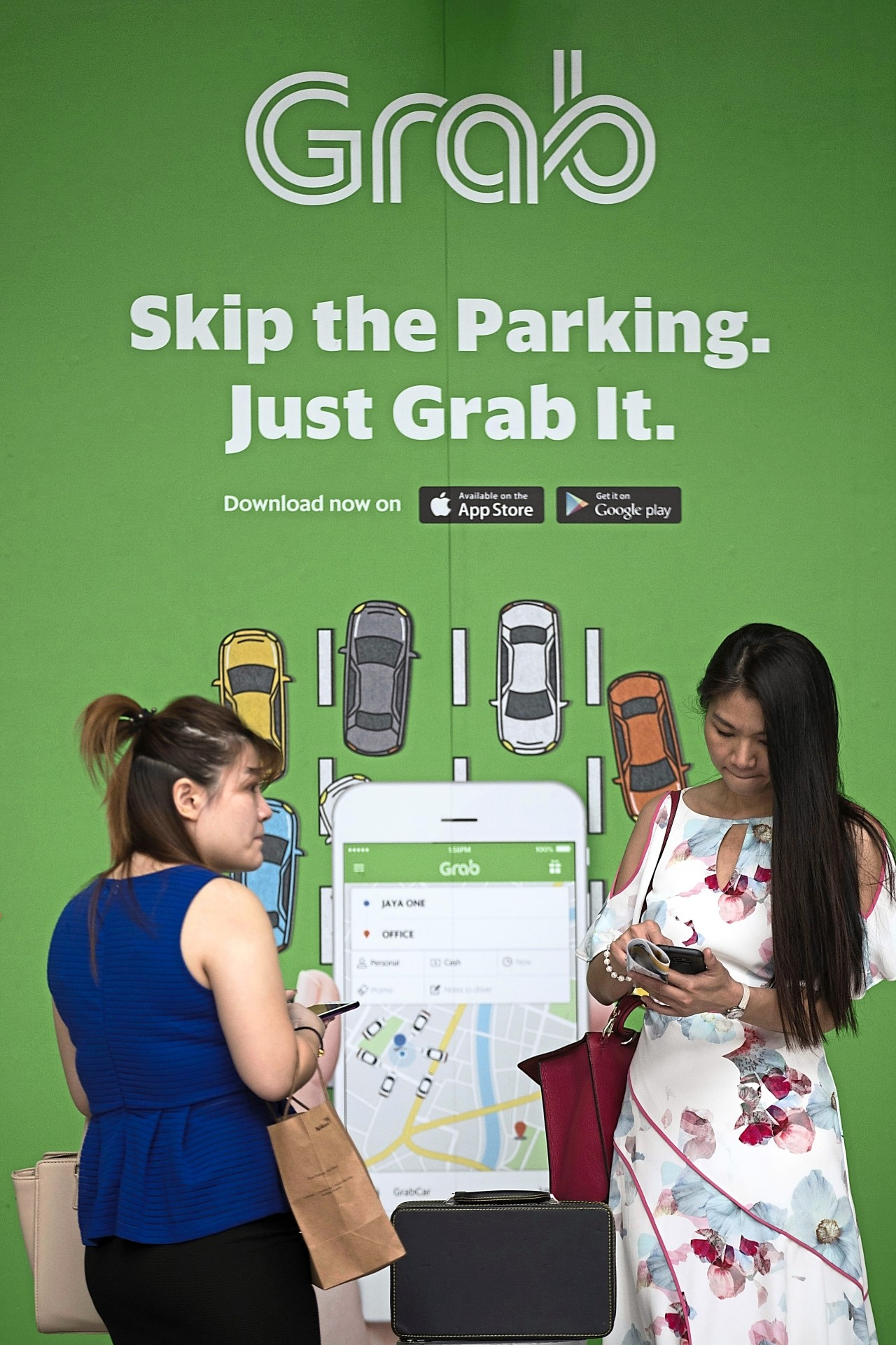 Grab's e-wallet is the first in Malaysia to adopt the DuitNow QR tech. — AP
