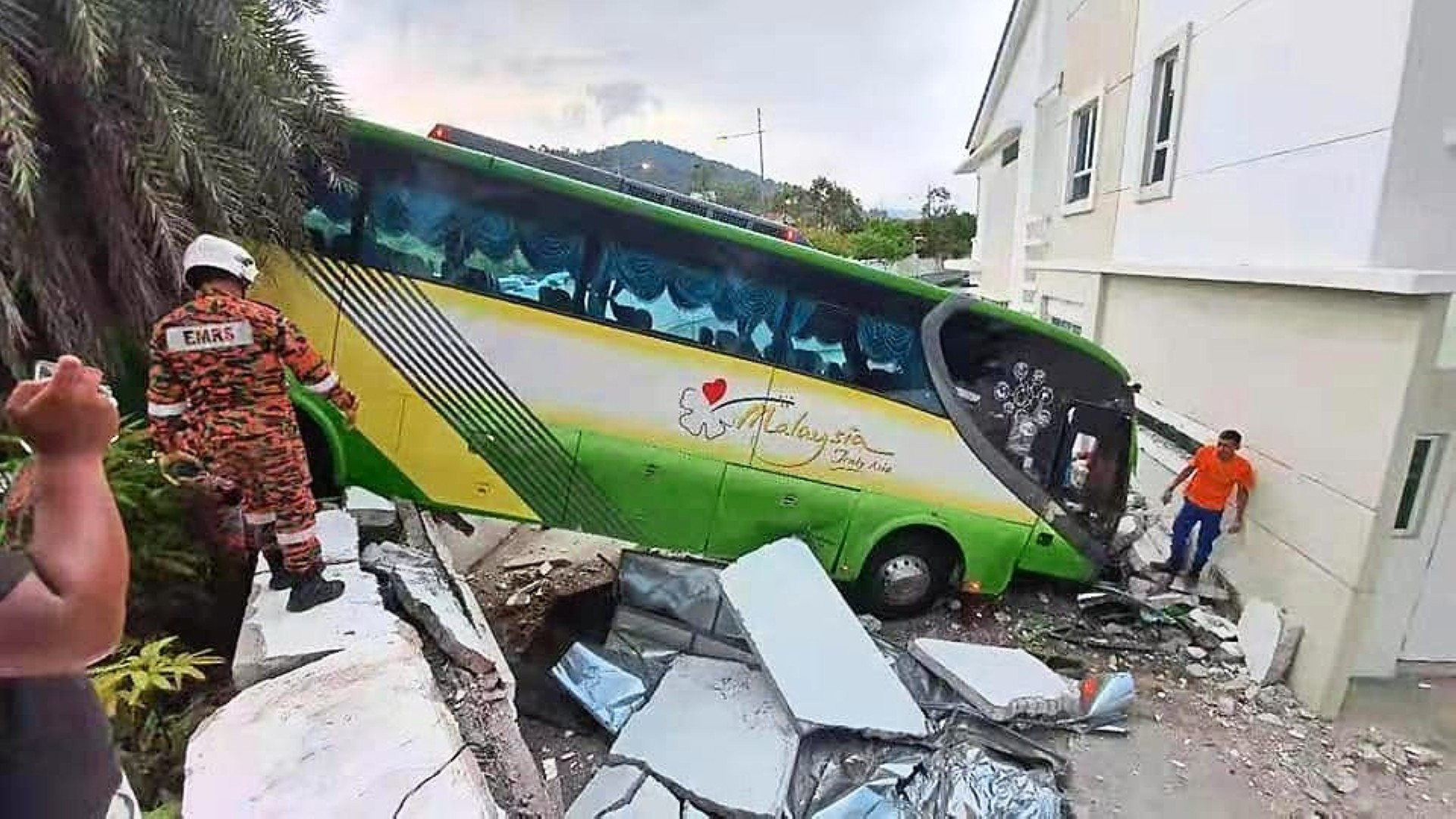 Out of control: A Fire and Rescue Department official checking the accident scene where a bus rammed into several vehicles at the traffic light junction in Jalan Kelicap near Setia Triangle, Bayan Lepas.
