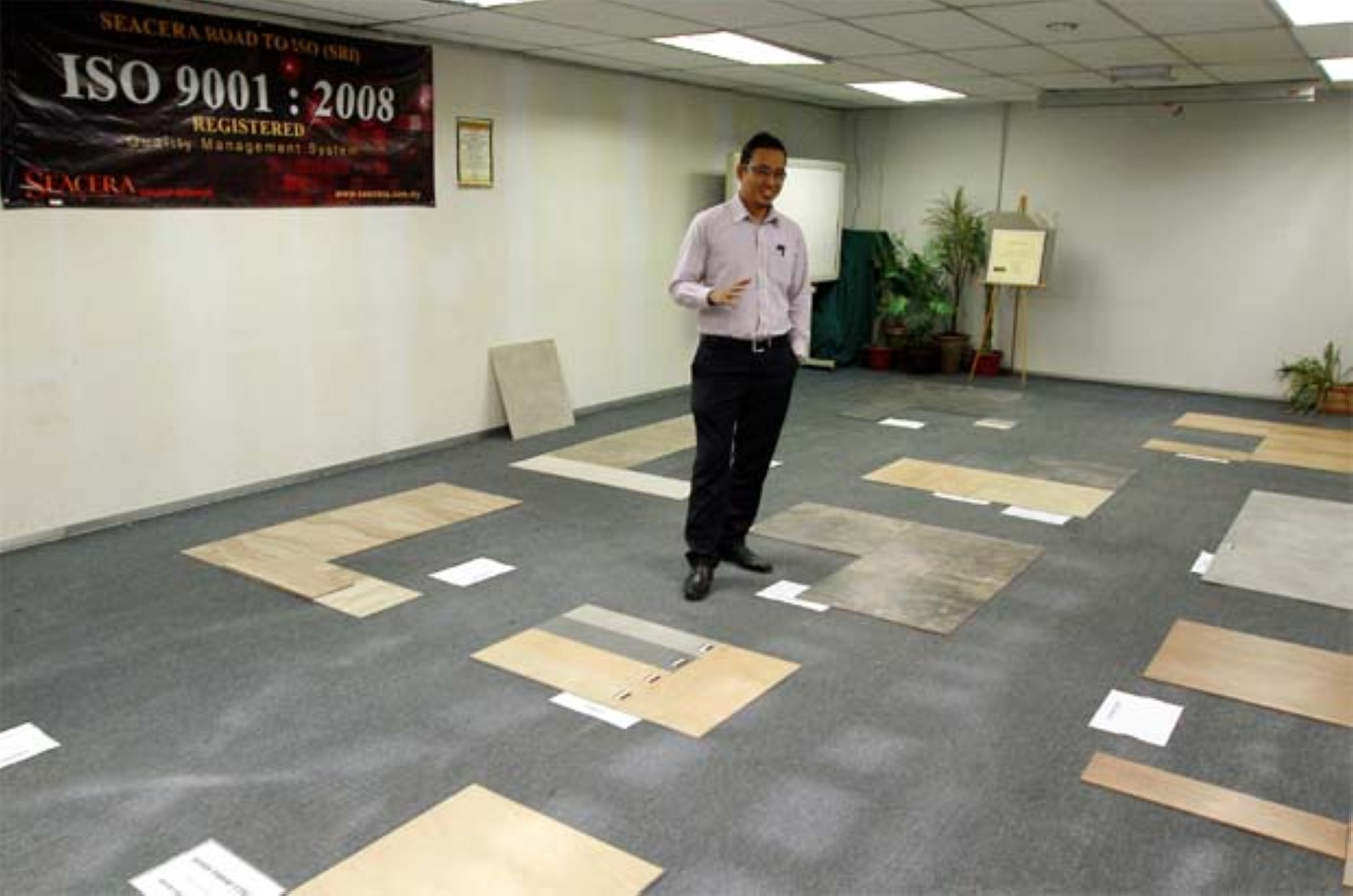 An official showing Seacera's tiles.
