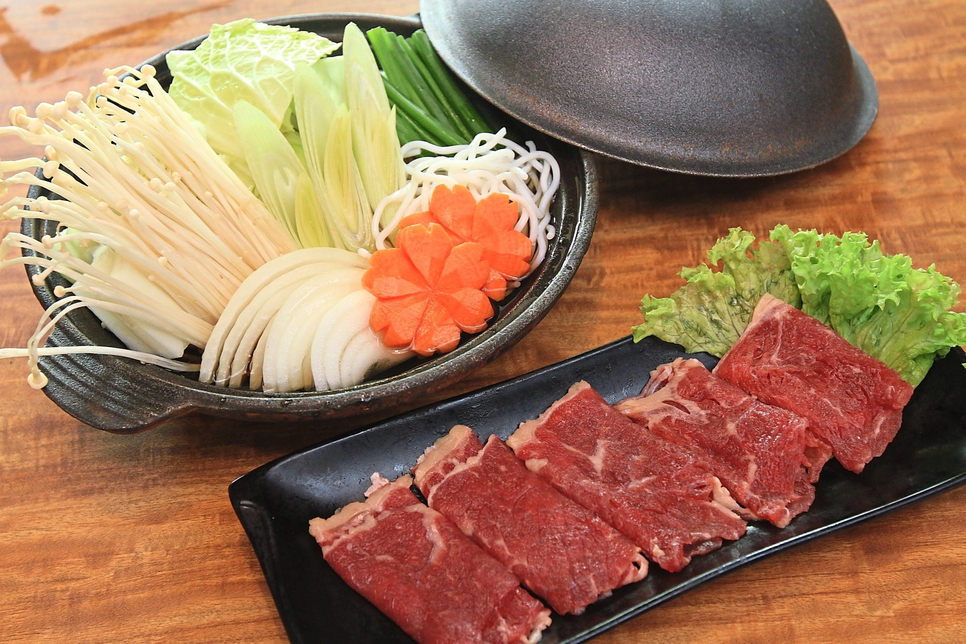 Sukiyaki-Style Zen Beef Set is one of the new beef dishes. The beef slices are served raw, then dipped in boiling soup.