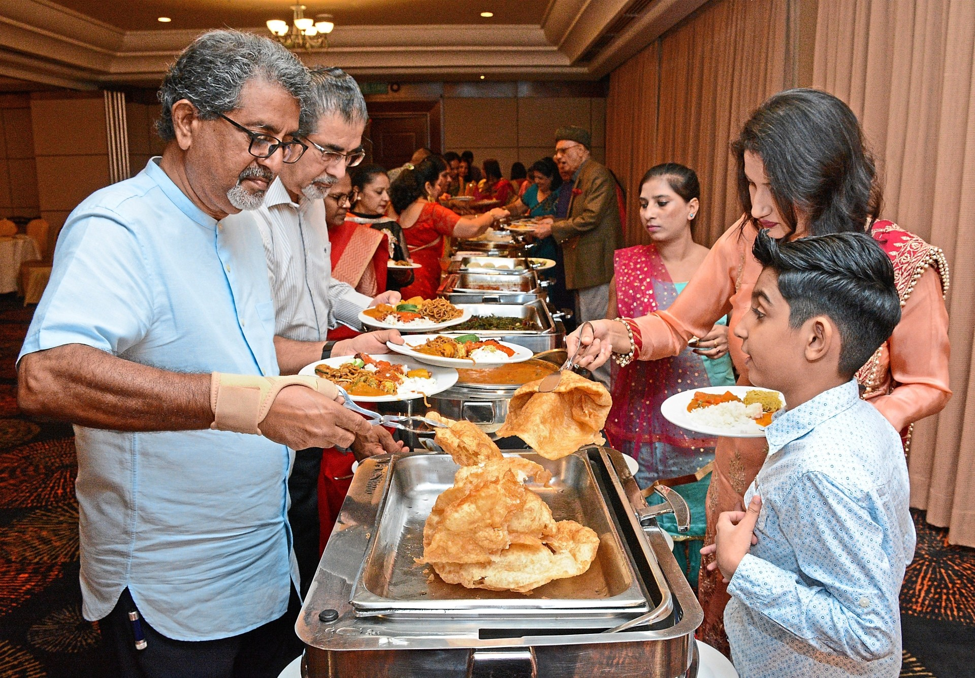 Guests helping themselves to the delicious buffet at The Gurney Resort Hotel and Residences in George Town.