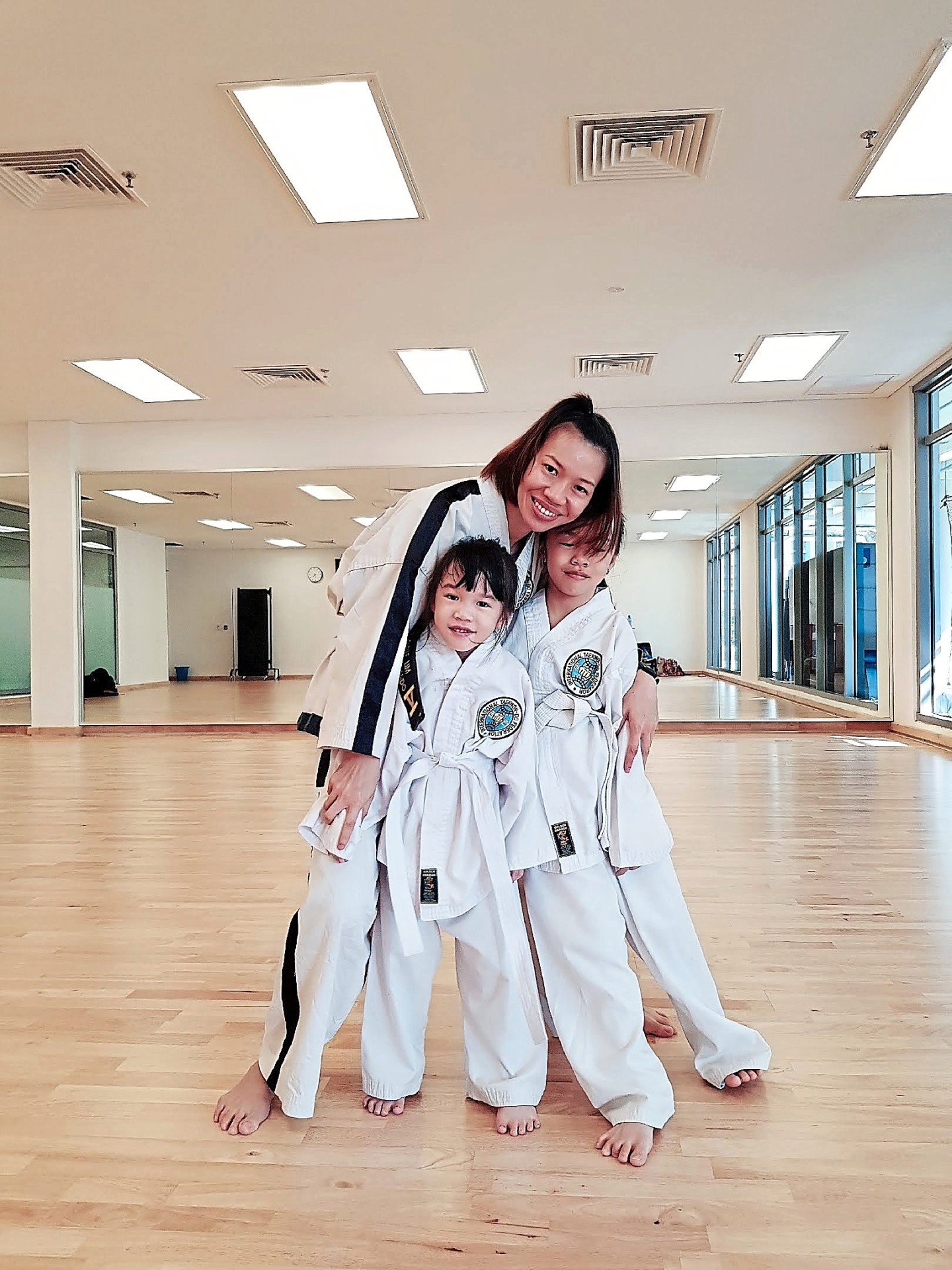 Lim's two daughters, Daphne Ng Yi Qing, eight, and Sarah Ng Xin Ning, five, started picking up taekwondo early this year.