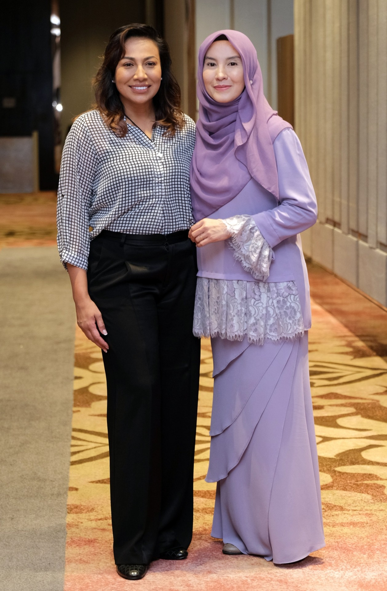 Ning Baizura (left) as Datin Paduka Marina Mahathir and Lisdawati as Nurul Izzah.