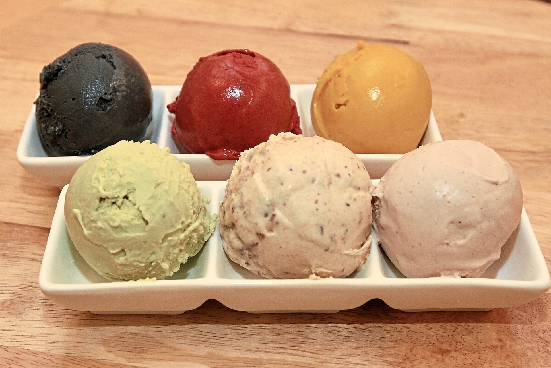 All the ice-creams at Sweet Escape have 25% less sugar than traditional ice-creams. Clockwise from top left: coconut ash, mixed berry sorbet, mango sorbet, strawberry basil, sticky date and pistachio.