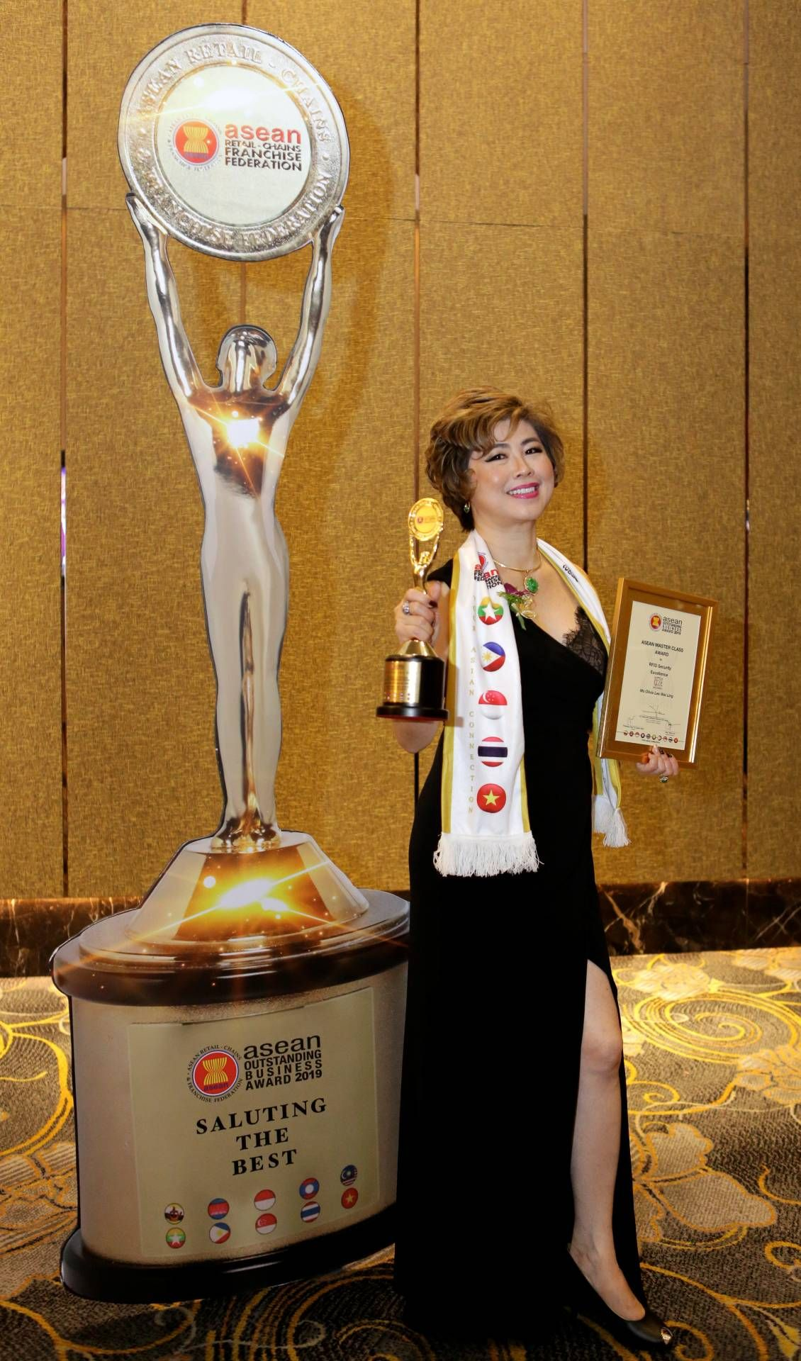 Lee with her recent award at the Asean Outstanding Business Awards 2019. Photo: The Star/Yap Chee Hong