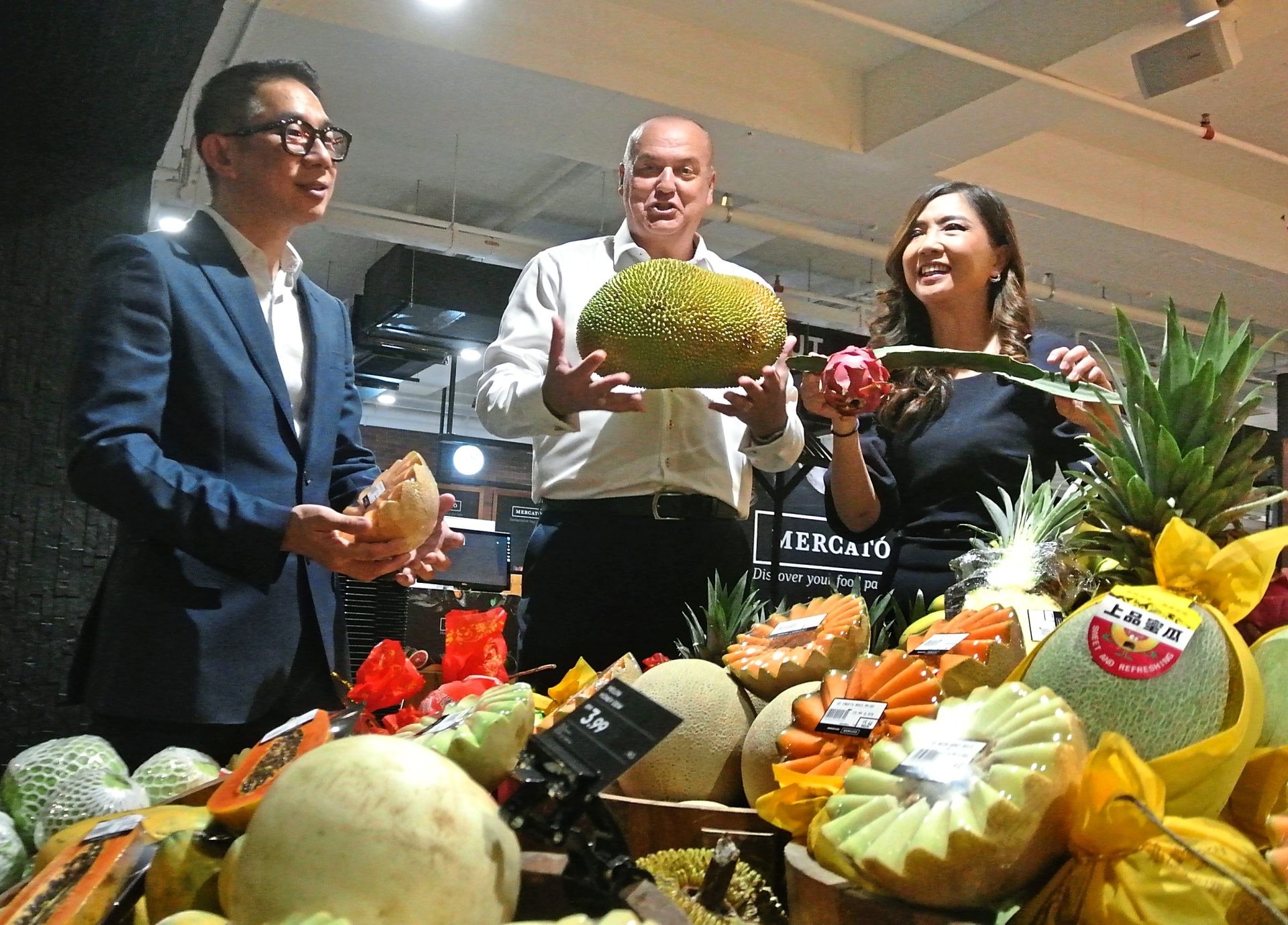 (From left) Chan, Scates and Ng checking out the fruits during Mercato's opening in Gurney Plaza, George Town.