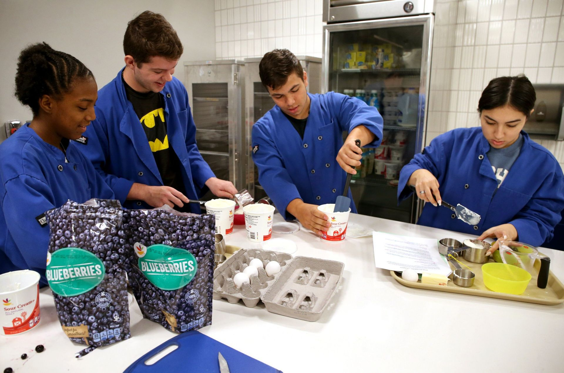 The students work in teams of four to prepare muffins in the spanking new culinary lab.