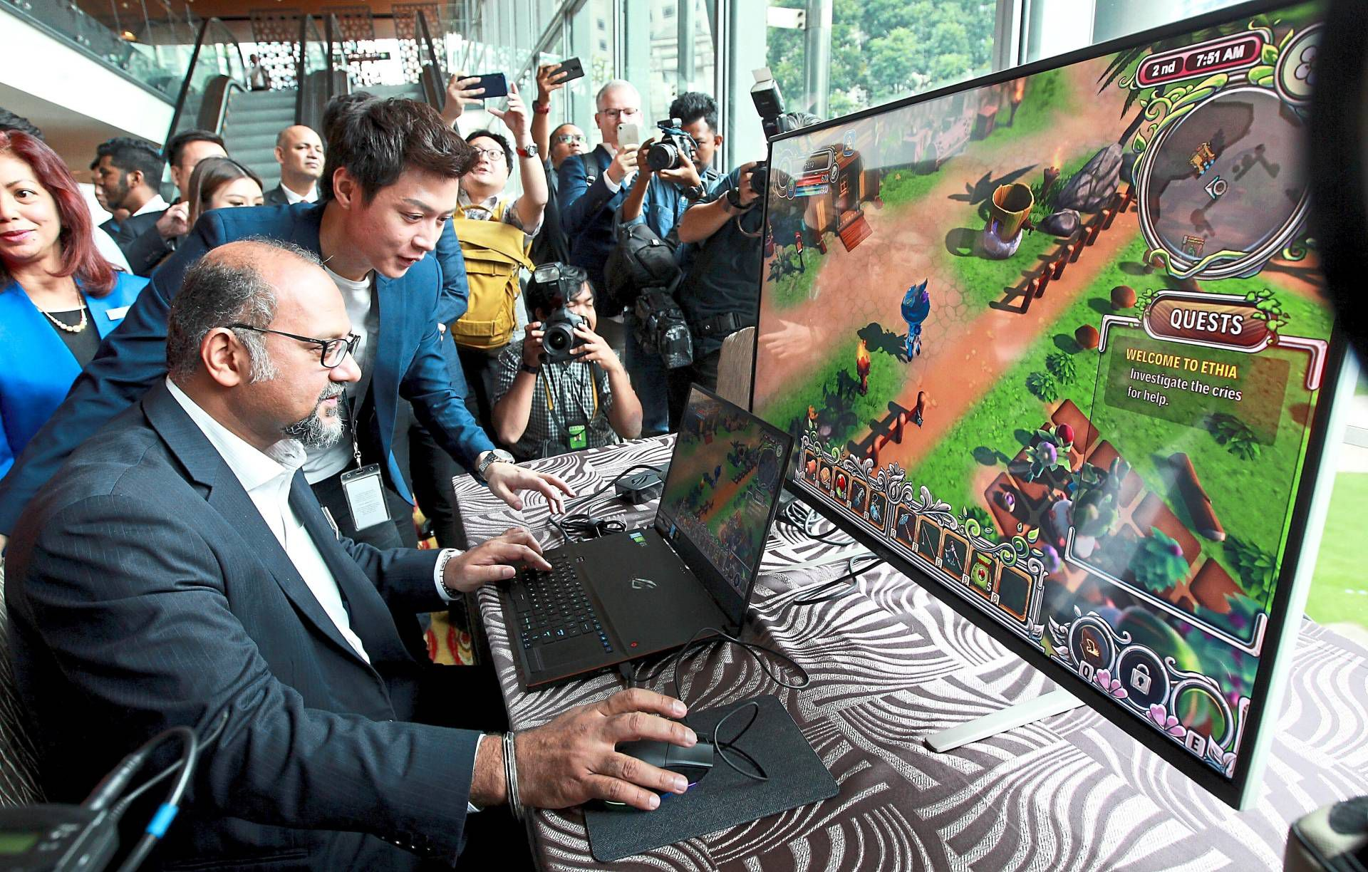 Left: Gobind checks out a game at Level Up KL after announcing that SIE WWS will be setting up a studio locally. — NORAFIFI EHSAN/The Star