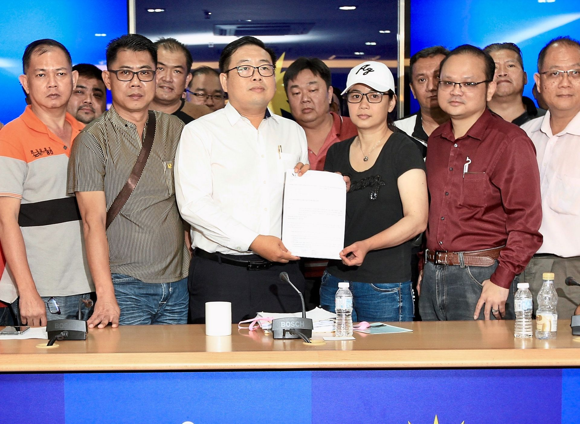 Demanding action: Ng with Yip showing the LOD that was sent to the Transport Ministry and Grab during a press conference in Kuala Lumpur.