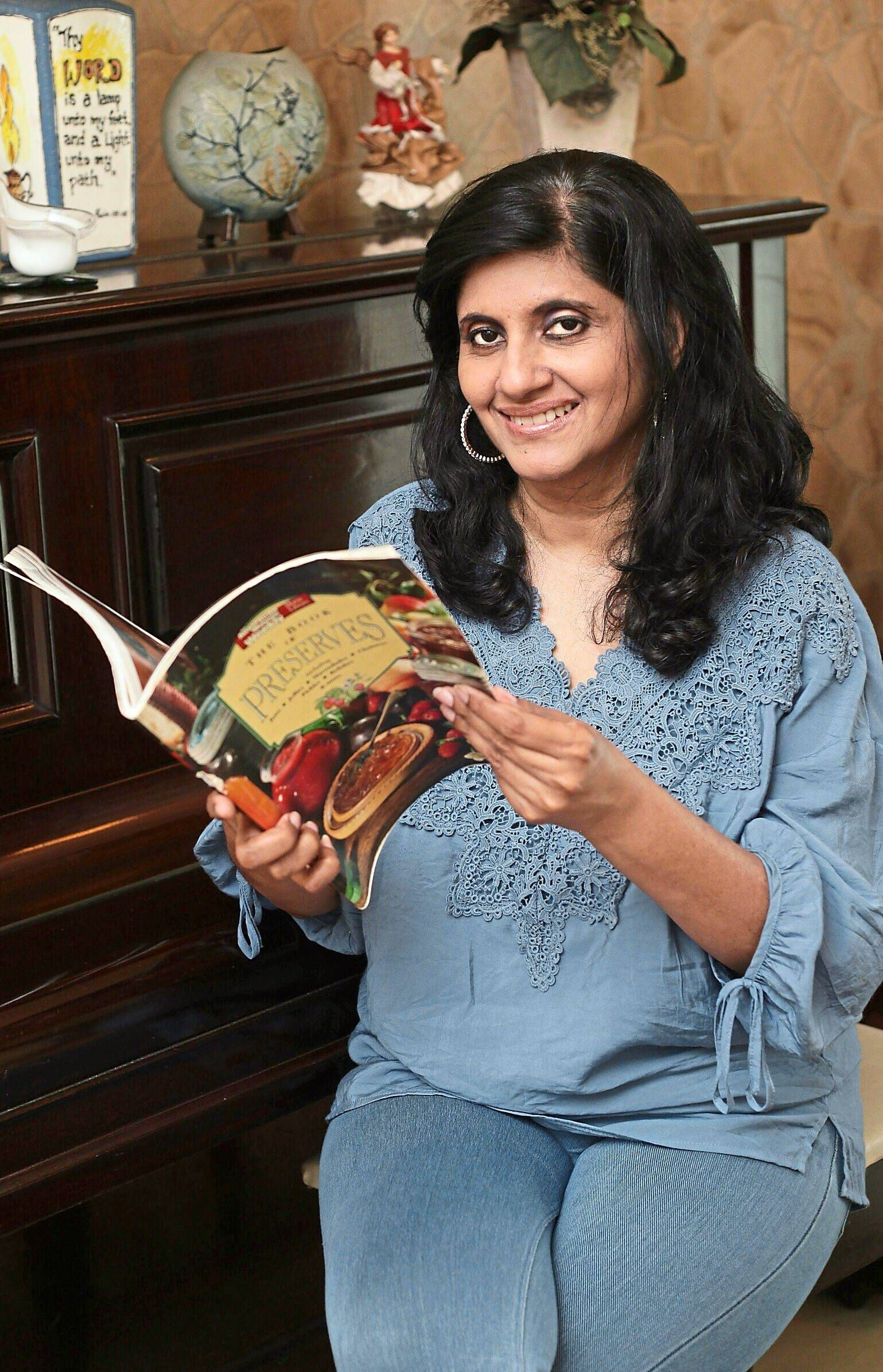 Pam perusing the recipe book that propelled her into making jams. — Photos: AZMAN GHANI/The Star