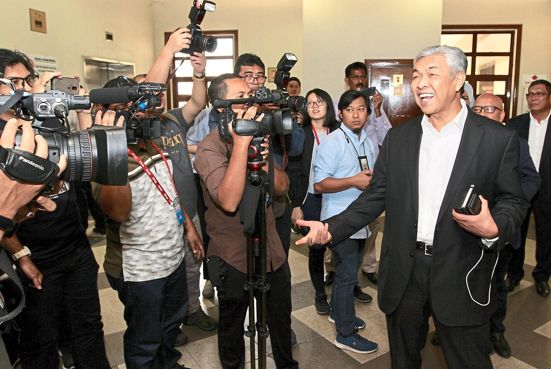 Jovial talk: Ahmad Zahid chatting with the media during a break at the Kuala Lumpur High Court.