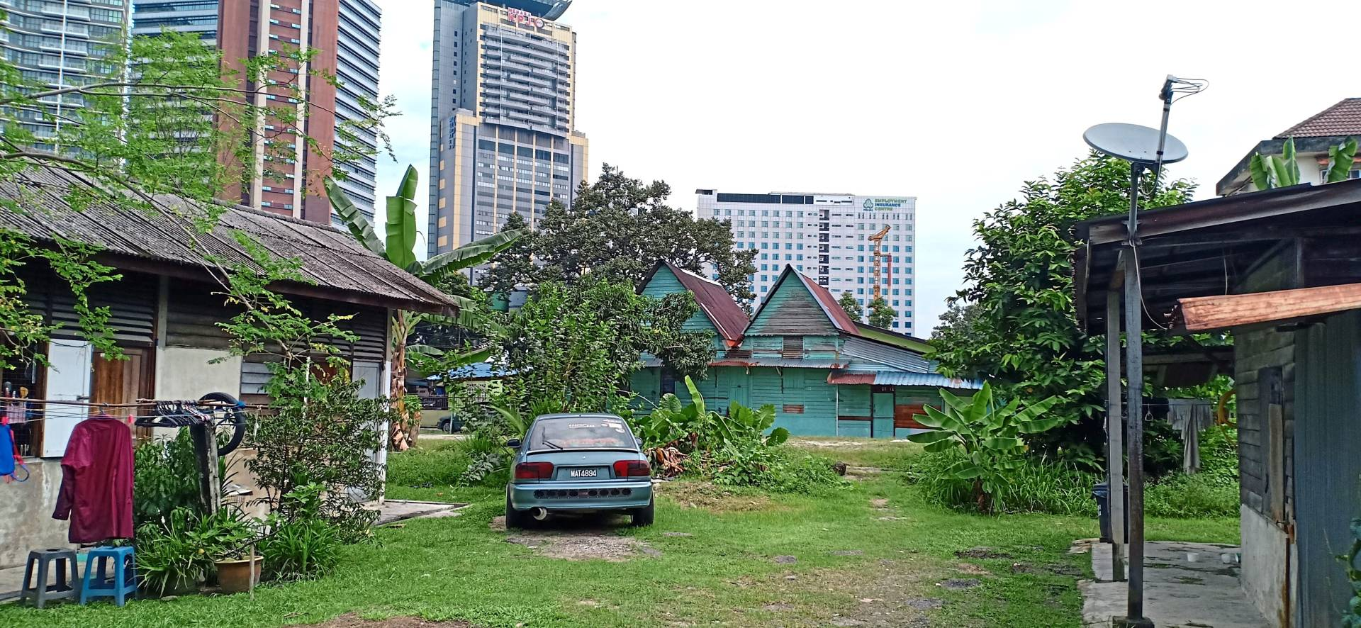 Wooden houses in Kampung Baru hark back to a time before Kuala Lumpur became  a bustling metropolis.