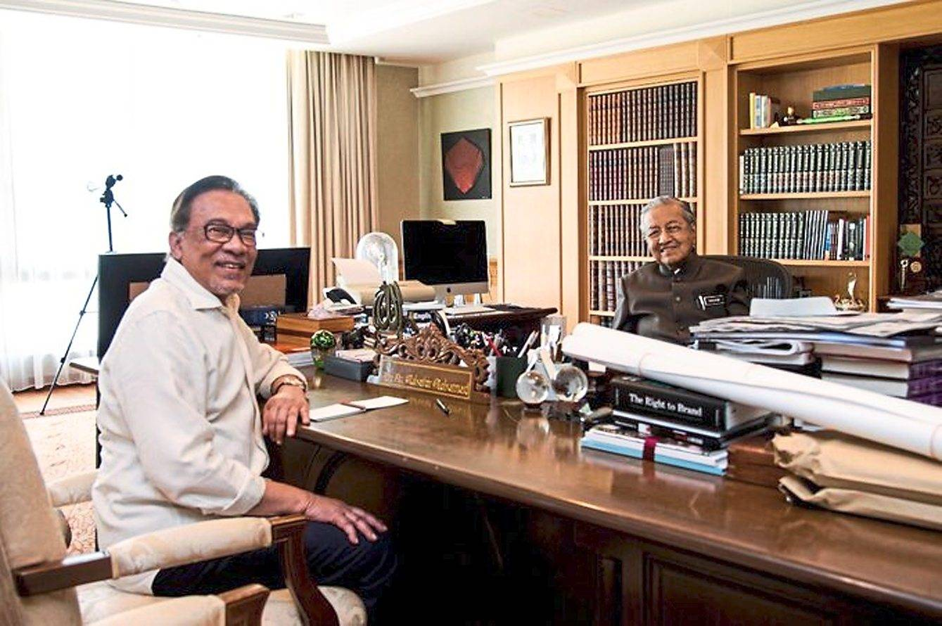 Working together:  Dr Mahathir and Anwar during a meeting at the Perdana Leadership Foundation in Putrajaya in this image from Anwar's Twitter account.