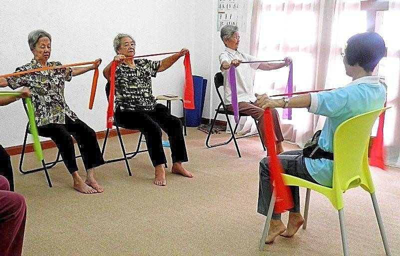 Strength training, as seen in this filepic of seniors doing resistance band exercises, is a crucial, but often neglected, part of ageing well.