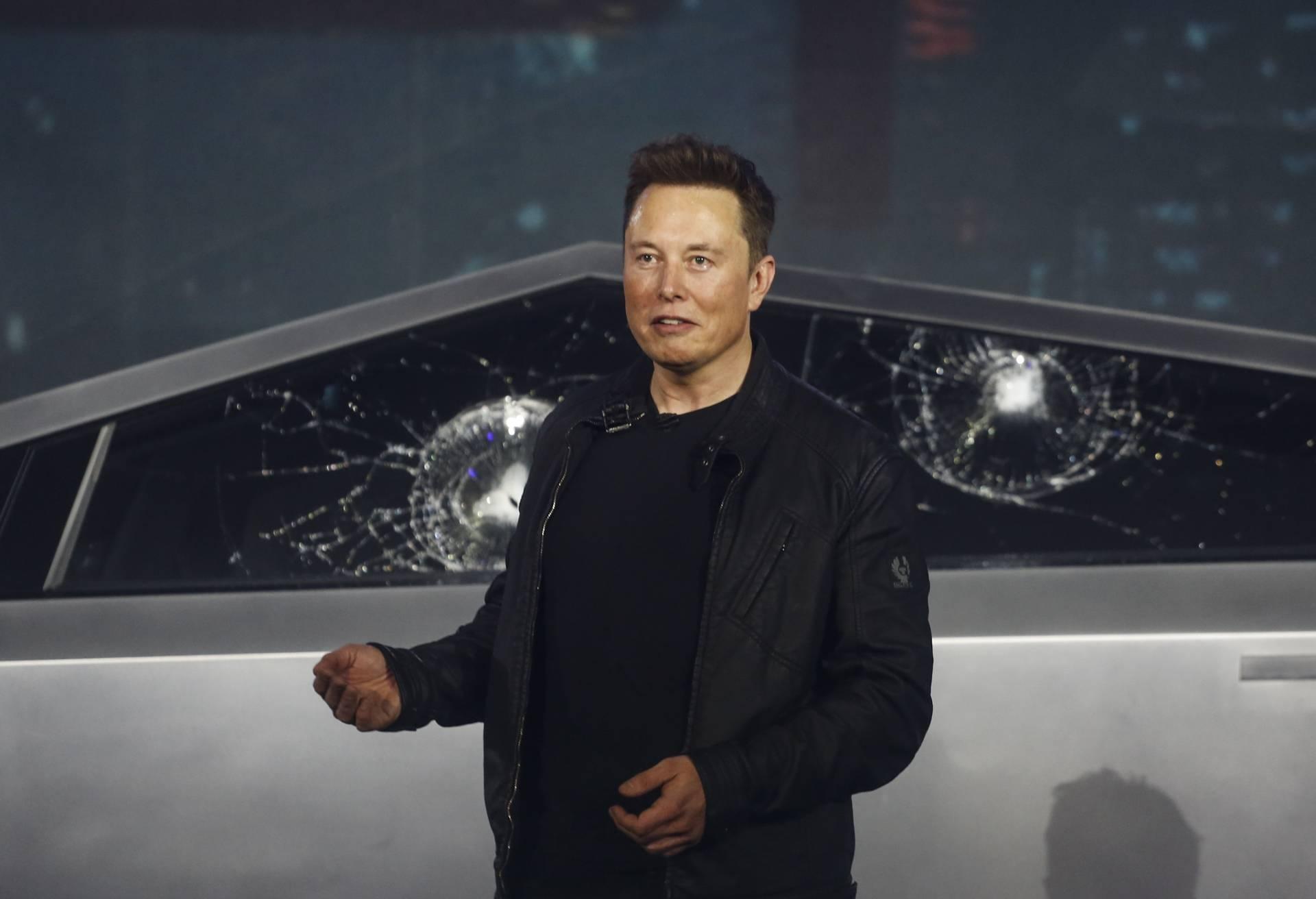 نتيجة بحث الصور عن Tesla suffers broken glass mishap at launch of new truck | AFP