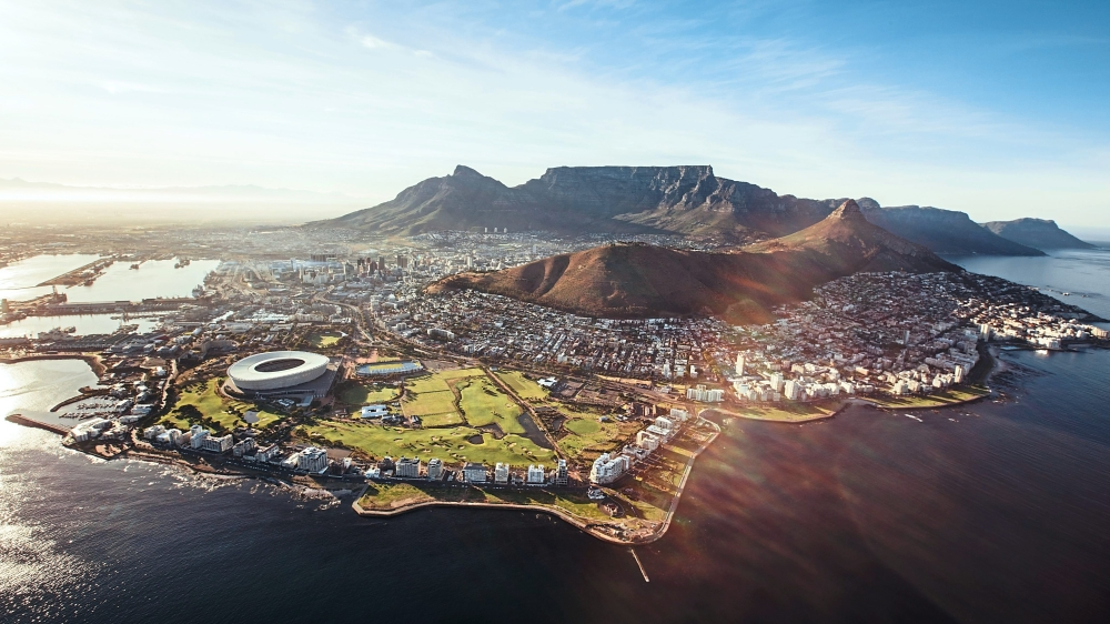 Aerial view of Cape Town with Cape Town Stadium, Lion's Head and Table mountain. — Cathay Pacific