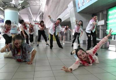 Zombies lurking around at a train station.