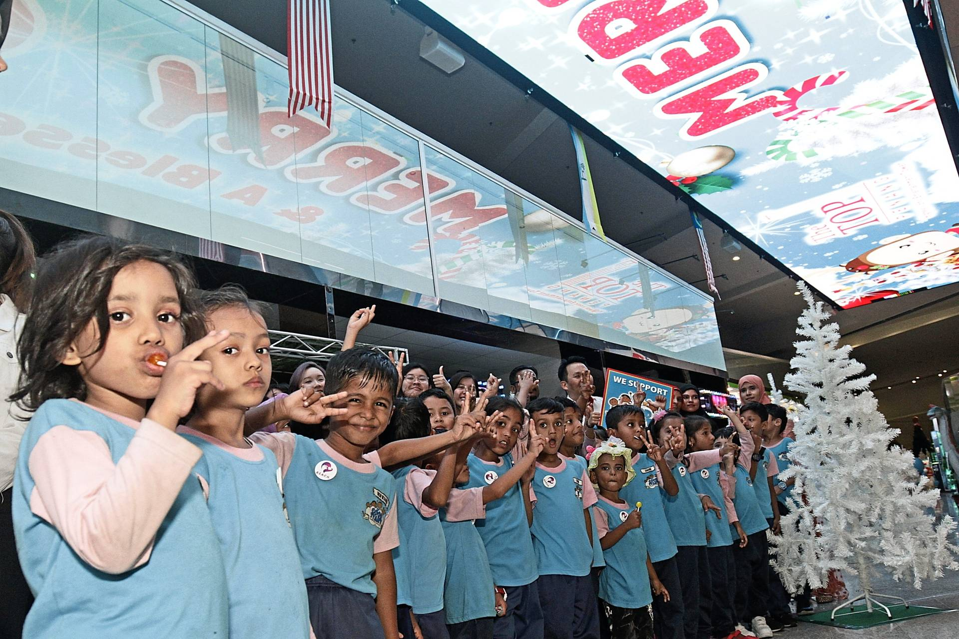 The children expressing their happiness during the Doraemon launch.