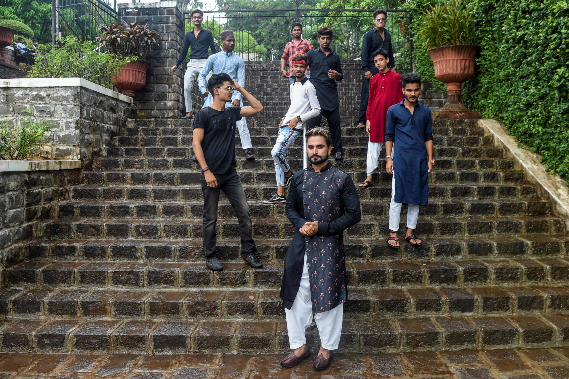 Mentor Akhtar Shaikh (front, centre) posing with his friends after recording a video for the video-sharing app TikTok, in Mumbai.
