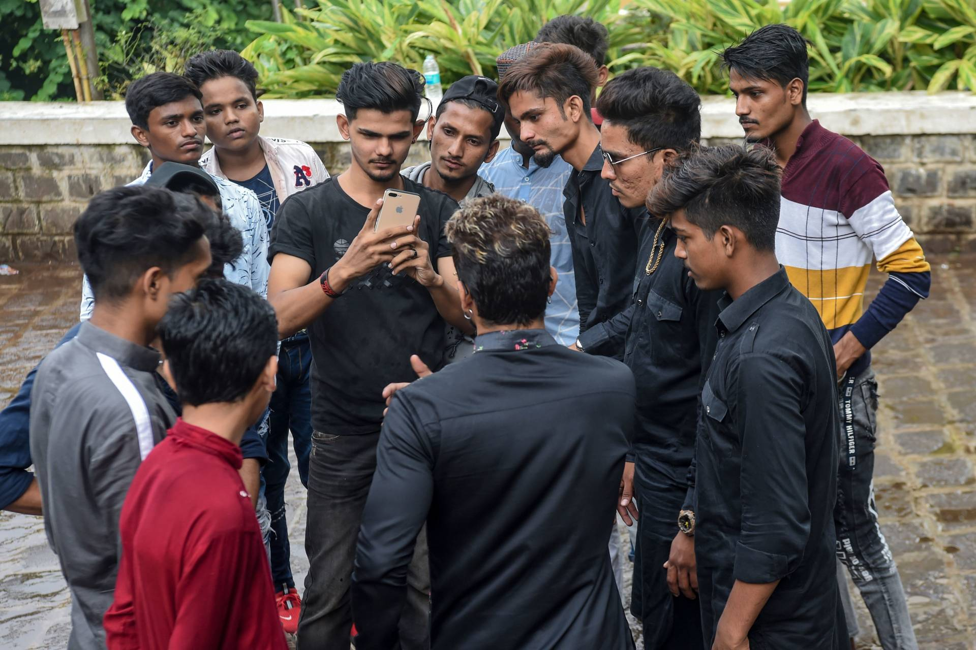 Youngsters gathering around mentor Akhtar Shaikh (back to camera) before a video-recording session in Mumbai.