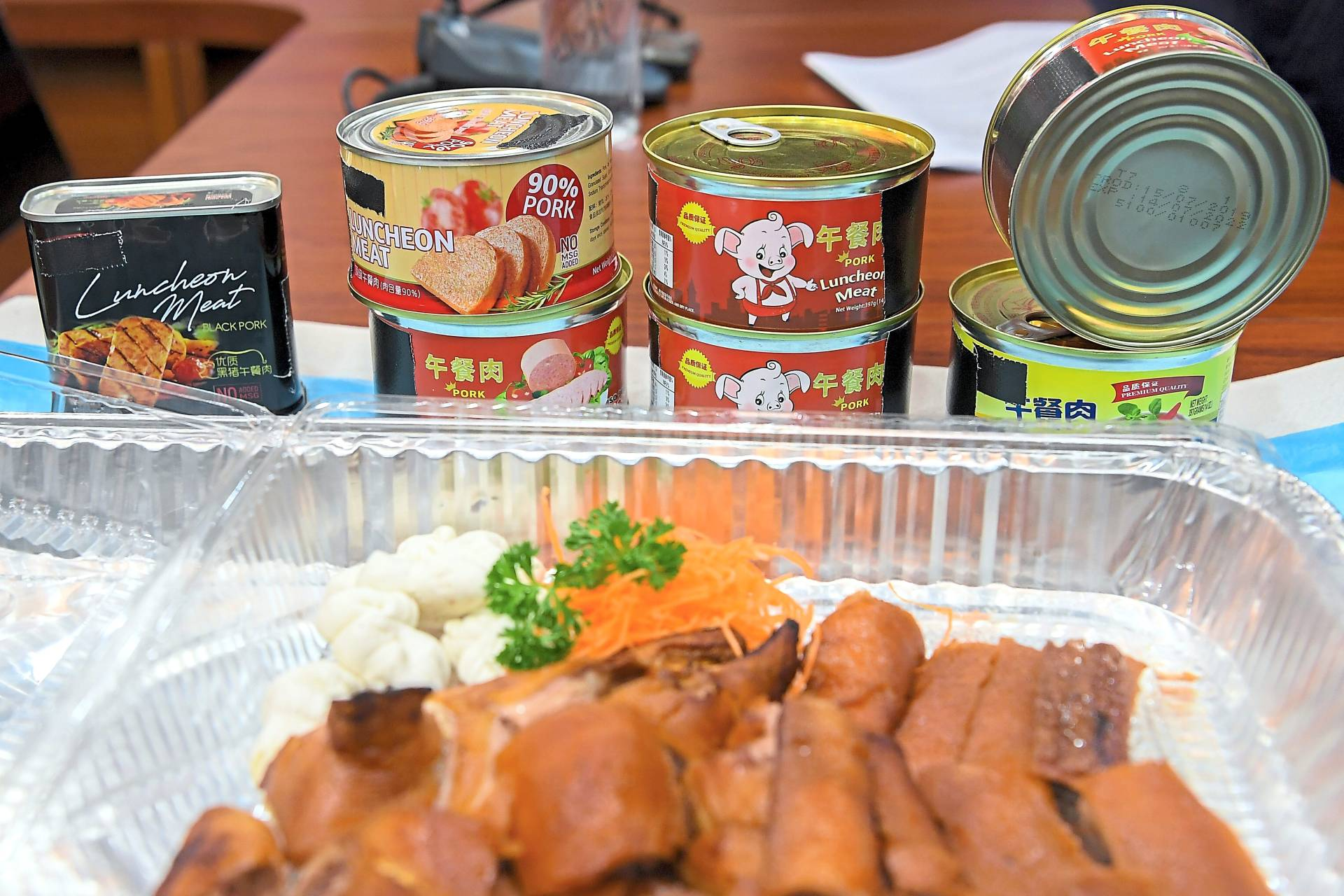 Some of the pork luncheon meat products seized after Sarawak declared a ban on such products imported from China recently. — Filepic