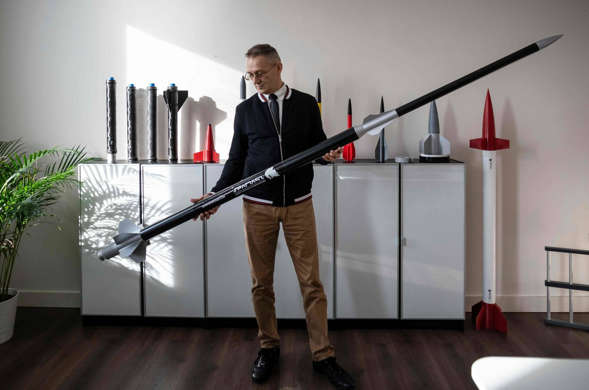 Huczala poses with parts of an Aerostatic Rocket Launcher (ARL) drone at his company's headquarters. The Aerostatic Rocket Launcher (ARL) drone can send a rocket 90 kilometres above the earth's surface, or high enough to place a nanosatellite in orbit, according to Huczala.