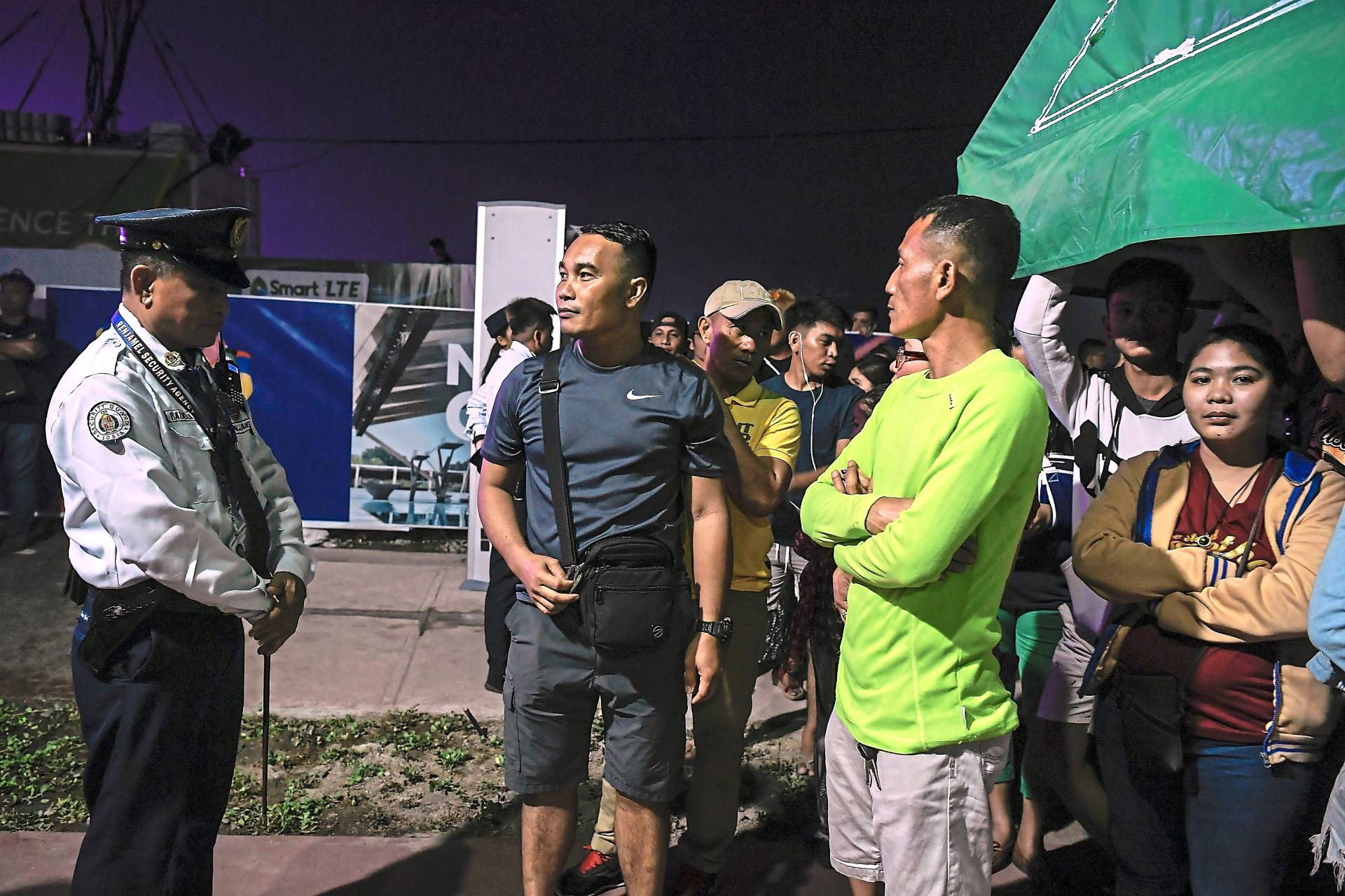 So close yet so far: Hundreds of members of the public were blocked from entering the stadium to watch the SEA Games opening ceremony. Security personnel said that they were acting on orders from higher authorities. —Bernama