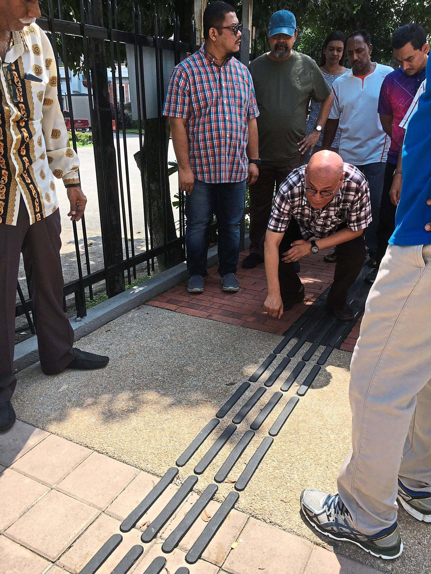 Nor Hisham checking out a tactile pathway installed in Brickfields. — Filepic