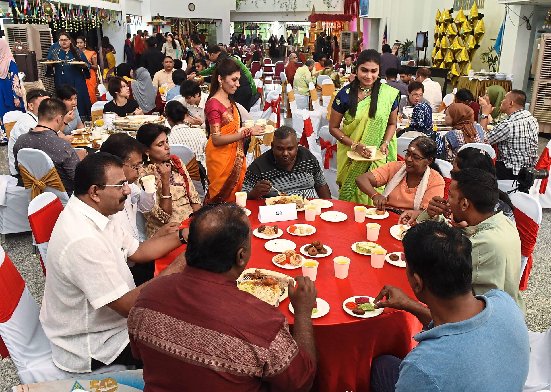 Guests mingling during the PDC Deepavali open house.