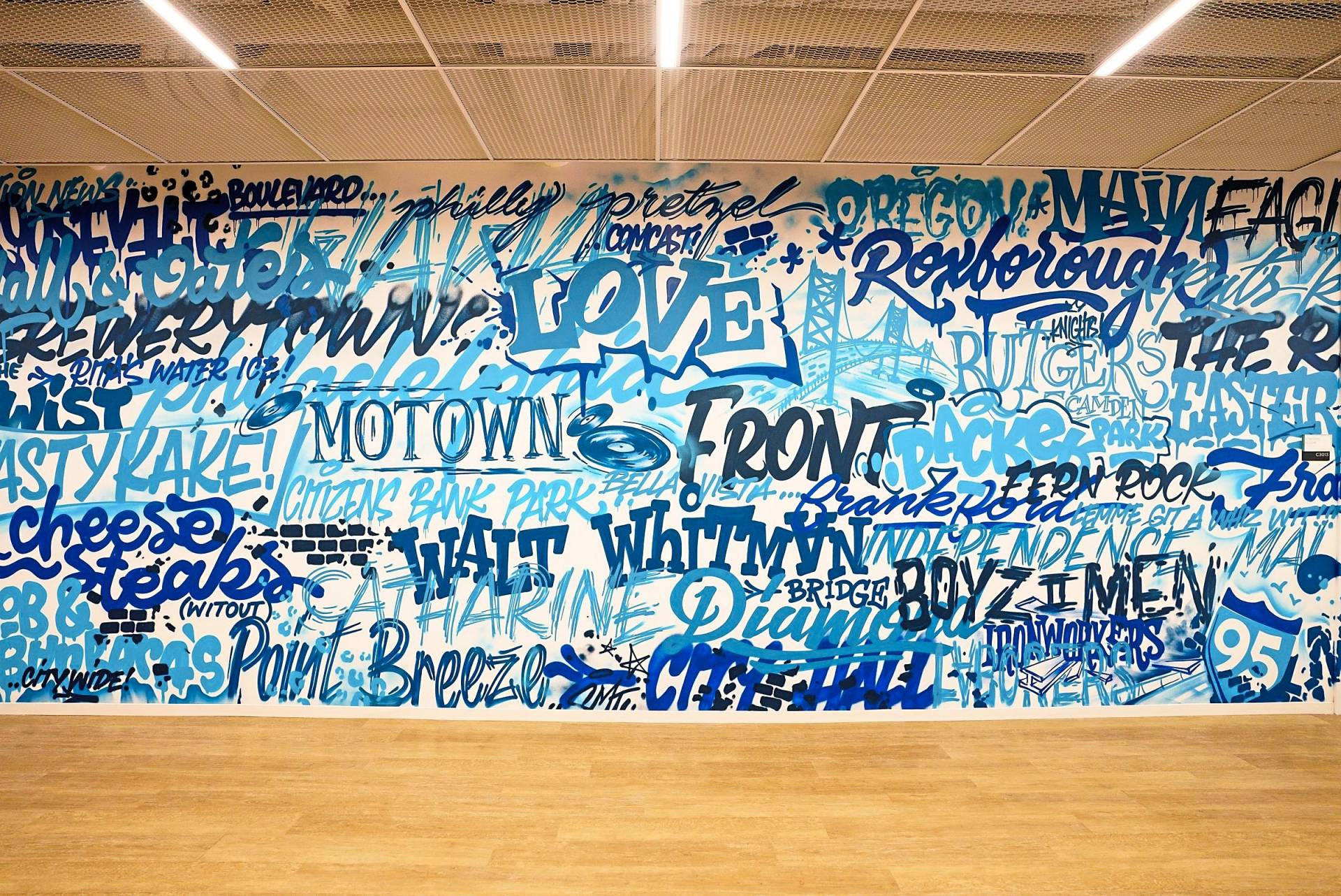 The Comcast Tech Center is filled with art, such as this piece by Glossblack, which was painted freehand and composed in the moment on the day of the installation, and which includes a number of Philadelphia references.