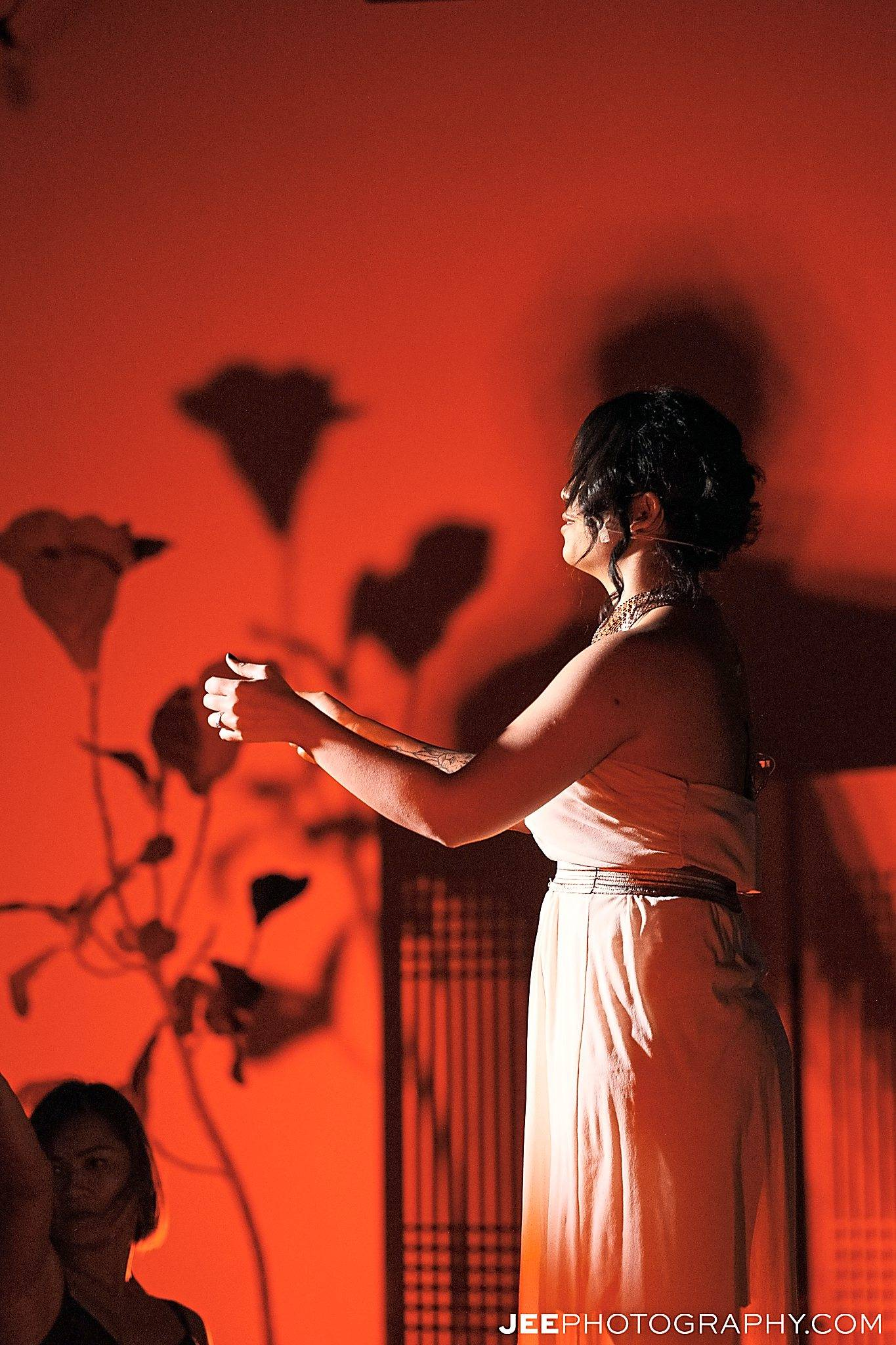 Performer Alia Kearney stops to smell the 'flowers'. Photo: Jee Photography