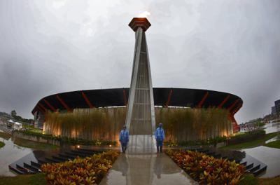 Two security personnel wearing raincoat standing in front of the SEA Games cauldron during bad weather brought by Typhoon Tisoy, December 4, 2019. FAIHAN GHANI/The Star