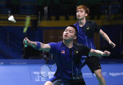 Malaysian doubles shuttlers Aaron Chia-Soh Wooi Yik in action against Indonesians Fajar Alfian-Muhammad Rian Ardianto in the men\'s team final during the SEA Games in Muntinlupa Sports Complex, Manila. December 4, 2019. IZZRAFIQ ALIAS/The Star
