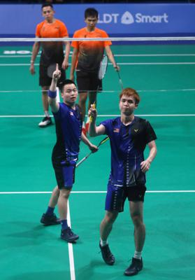Malaysian doubles shuttlers Aaron Chia-Soh Wooi Yik reacts after winning the match against Indonesians Fajar Alfian-Muhammad Rian Ardianto in the men\'s team final during the SEA Games in Muntinlupa Sports Complex, Manila, December 4, 2019 IZZRAFIQ ALIAS/The Star