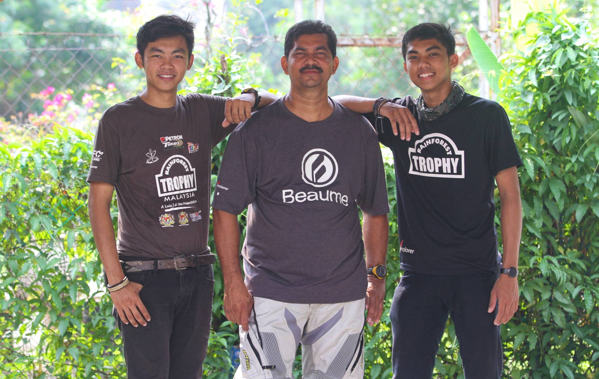 Satren (left) and Kevan (right) who are champions  of Rainforest Trophy 2019, a 4WD event, with their father, Rate De Silva, who also took part in the event. - MUHAMAD SHAHRIL ROSLI/The Star.